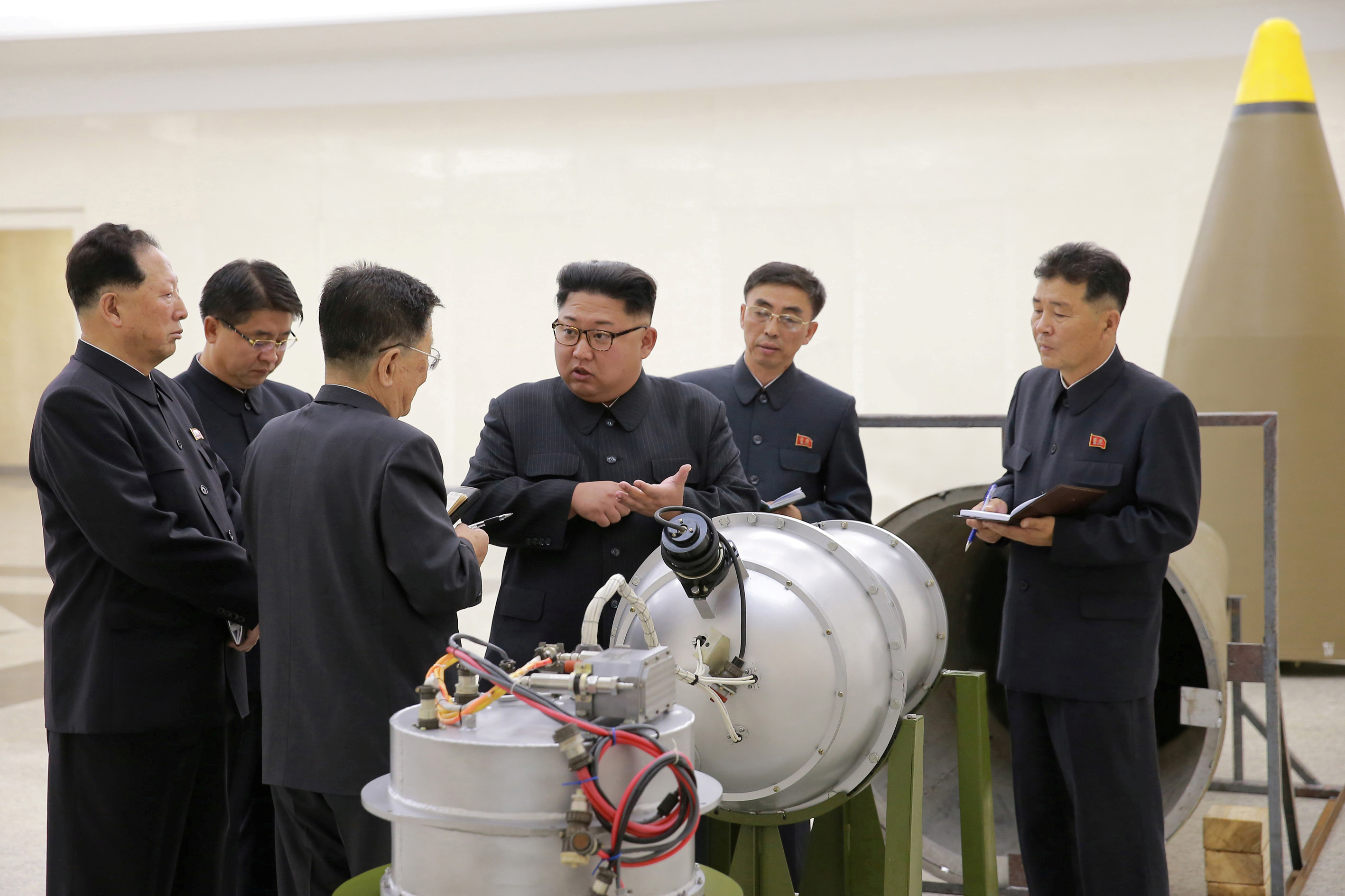 North Korean leader Kim Jong Un provides guidance with Ri Hong Sop (3rd L) and Hong Sung Mu (L) on a nuclear weapons program in this undated photo released by North Korea's Korean Central News Agency (KCNA) in Pyongyang September 3, 2017. KCNA via REUTERS ATTENTION EDITORS - THIS PICTURE WAS PROVIDED BY A THIRD PARTY. REUTERS IS UNABLE TO INDEPENDENTLY VERIFY THE AUTHENTICITY, CONTENT, LOCATION OR DATE OF THIS IMAGE. NOT FOR SALE FOR MARKETING OR ADVERTISING CAMPAIGNS. NO THIRD PARTY SALES. NOT FOR USE BY REUTERS THIRD PARTY DISTRIBUTORS. SOUTH KOREA OUT. NO COMMERCIAL OR EDITORIAL SALES IN SOUTH KOREA. THIS PICTURE IS DISTRIBUTED EXACTLY AS RECEIVED BY REUTERS, AS A SERVICE TO CLIENTS.