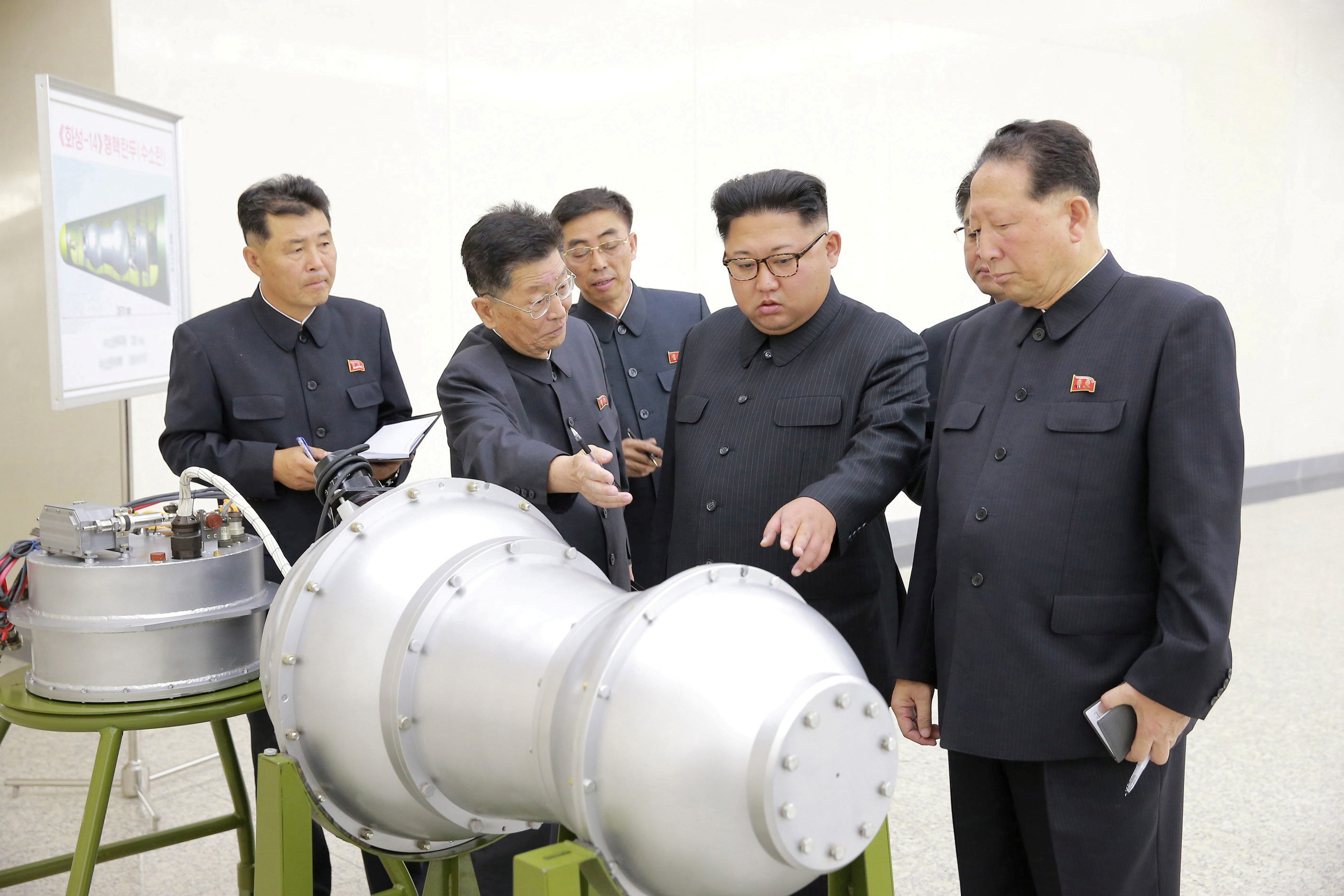 North Korean leader Kim Jong Un provides guidance with Ri Hong Sop (2nd L) and Hong Sung Mu (R) on a nuclear weapons program in this undated photo released by North Korea's Korean Central News Agency (KCNA) in Pyongyang September 3, 2017. KCNA via REUTERS ATTENTION EDITORS - THIS PICTURE WAS PROVIDED BY A THIRD PARTY. REUTERS IS UNABLE TO INDEPENDENTLY VERIFY THE AUTHENTICITY, CONTENT, LOCATION OR DATE OF THIS IMAGE. NOT FOR SALE FOR MARKETING OR ADVERTISING CAMPAIGNS. NO THIRD PARTY SALES. NOT FOR USE BY REUTERS THIRD PARTY DISTRIBUTORS. SOUTH KOREA OUT. NO COMMERCIAL OR EDITORIAL SALES IN SOUTH KOREA. THIS PICTURE IS DISTRIBUTED EXACTLY AS RECEIVED BY REUTERS, AS A SERVICE TO CLIENTS.