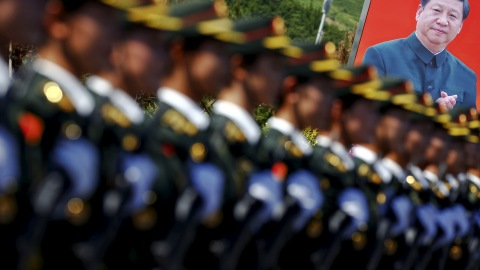 A picture of Chinese President Xi Jinping is seen behind soldiers of China's People's Liberation Army marching during a training session for a military parade to mark the 70th anniversary of the end of the World War Two, at a military base in Beijing, China, August 22, 2015. Troops from at least 10 countries including Russia and Kazakhstan will join an unprecedented military parade in Beijing next month to commemorate China's victory over Japan during World War Two, Chinese officials said. The parade on Sept. 3 will involve about 12,000 Chinese troops and 200 aircraft, Qi Rui, deputy director of the government office organizing the parade, told reporters in Beijing on Friday. REUTERS/Damir Sagolj      TPX IMAGES OF THE DAY      - GF10000179160