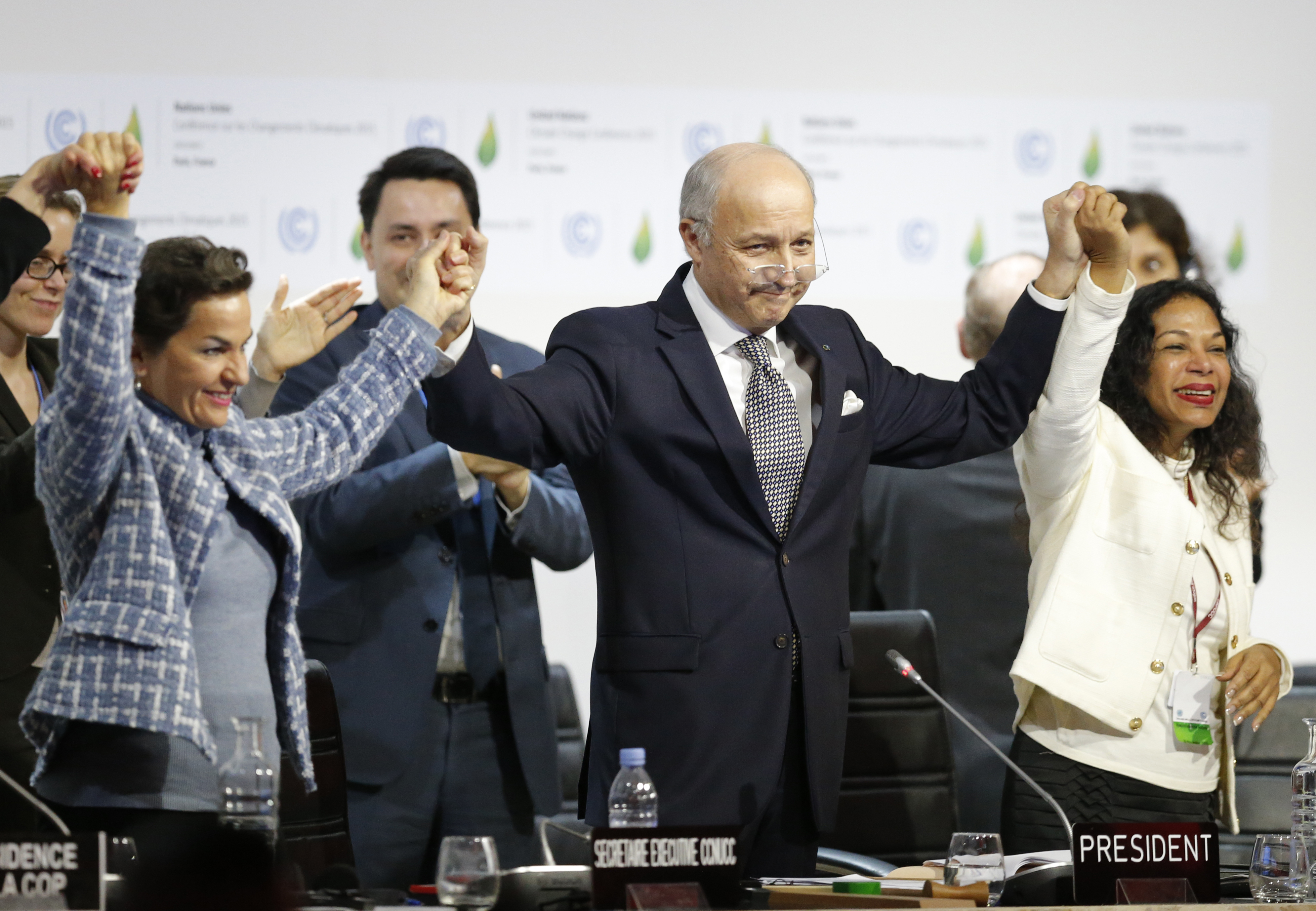 French Foreign Affairs Minister Laurent Fabius (C), President-designate of COP21, and Christiana Figueres (L), Executive Secretary of the UN Framework Convention on Climate Change, react during the final plenary session at the World Climate Change Conference 2015 (COP21) at Le Bourget, near Paris, France, December 12, 2015.     REUTERS/Stephane Mahe   - LR1EBCC1MTTOP