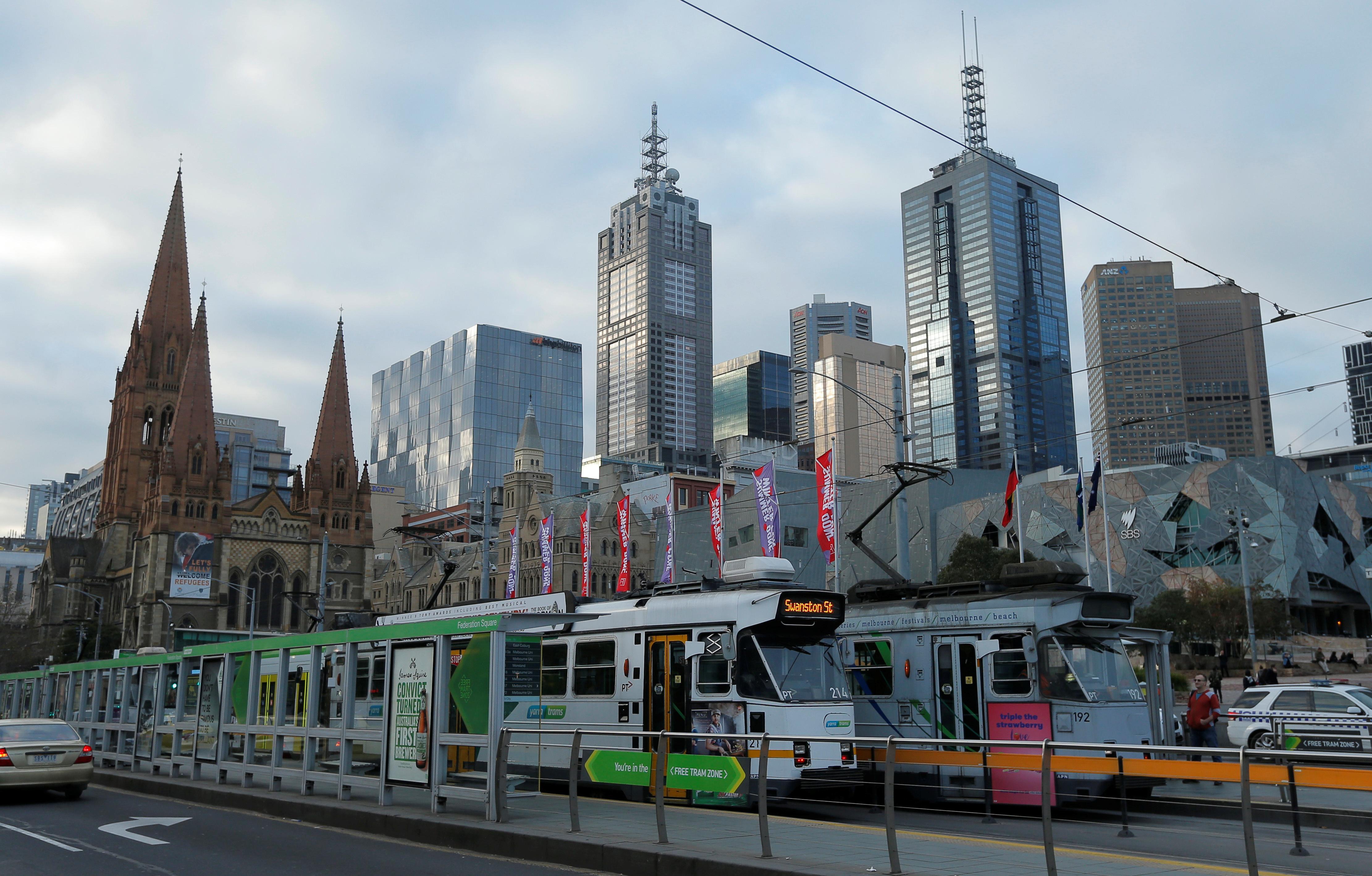 Trams pass by Melbourne's city skyline in Australia's second-largest city, June 13, 2017. REUTERS/Jason Reed - RC1B06D7E1B0