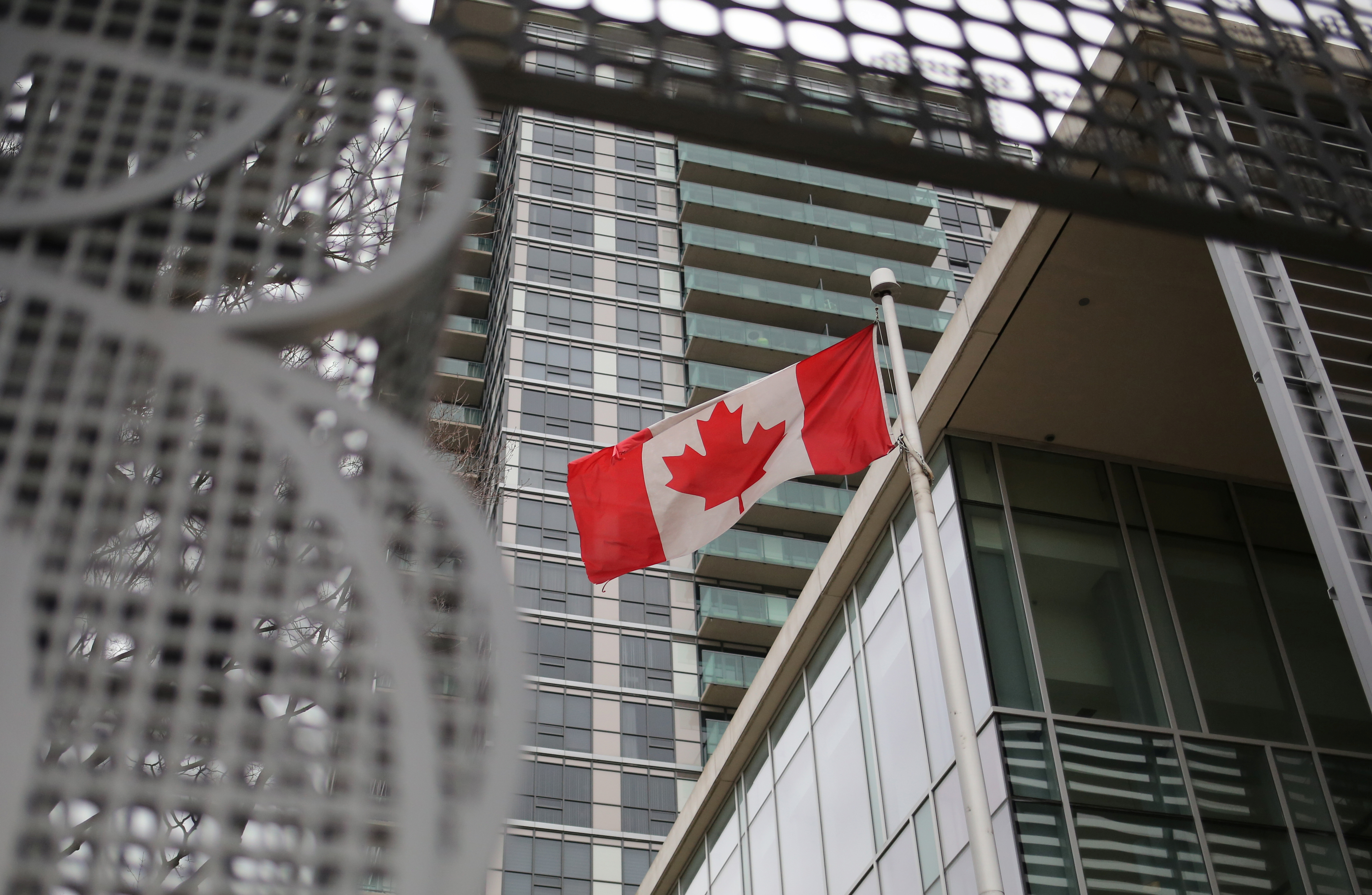 A Canadian flag flies outside the North Toronto Collegiate Institute, a high school run by the Toronto District School Board in Toronto, Ontario, Canada March 24, 2017.  REUTERS/Chris Helgren - RC1A92EC9340