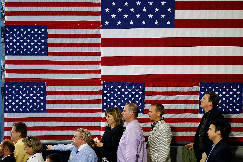 People listen as U.S. President Donald Trump speaks about tax reform.