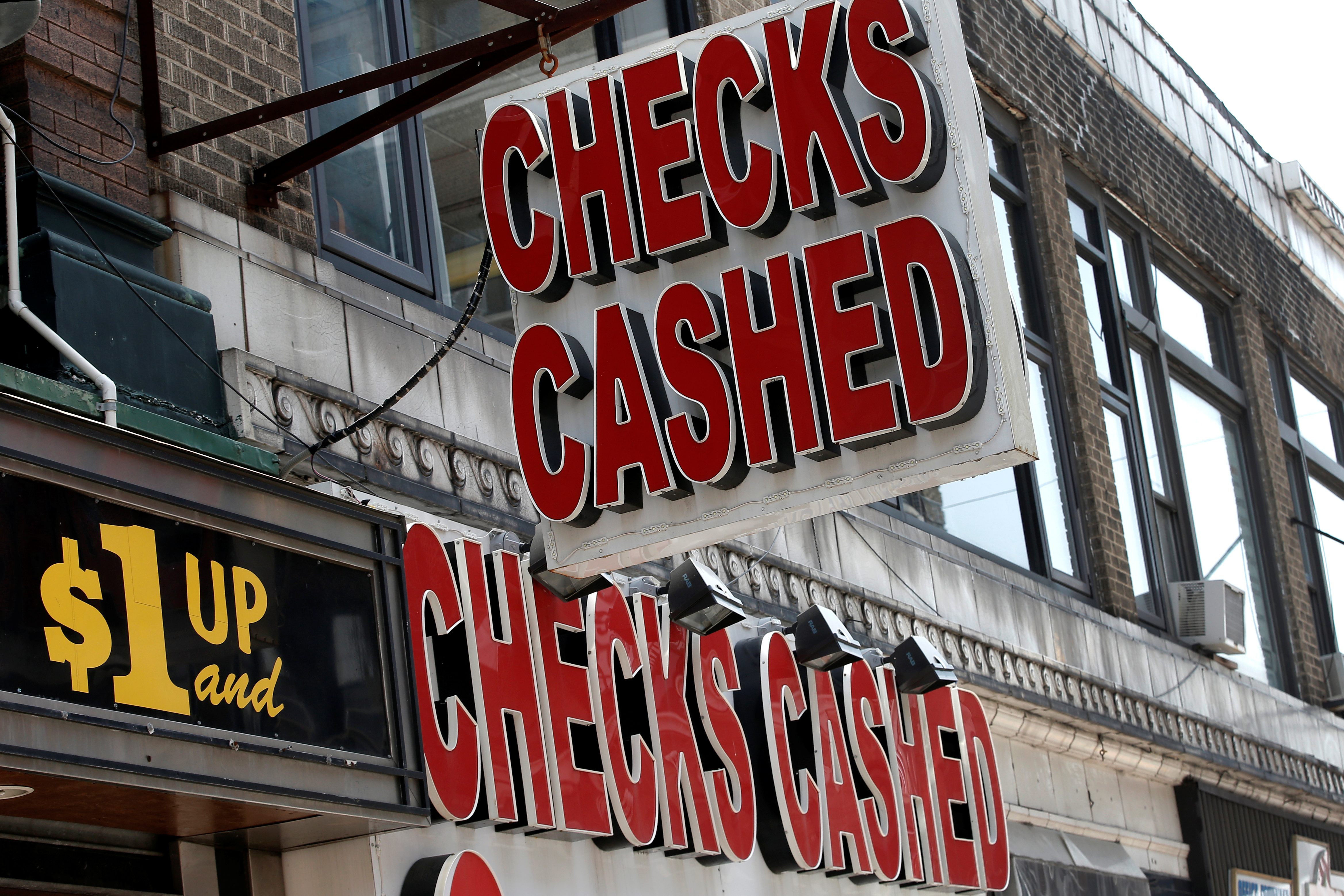 A sign is seen above a check cashing and loan shop in Jersey City.
