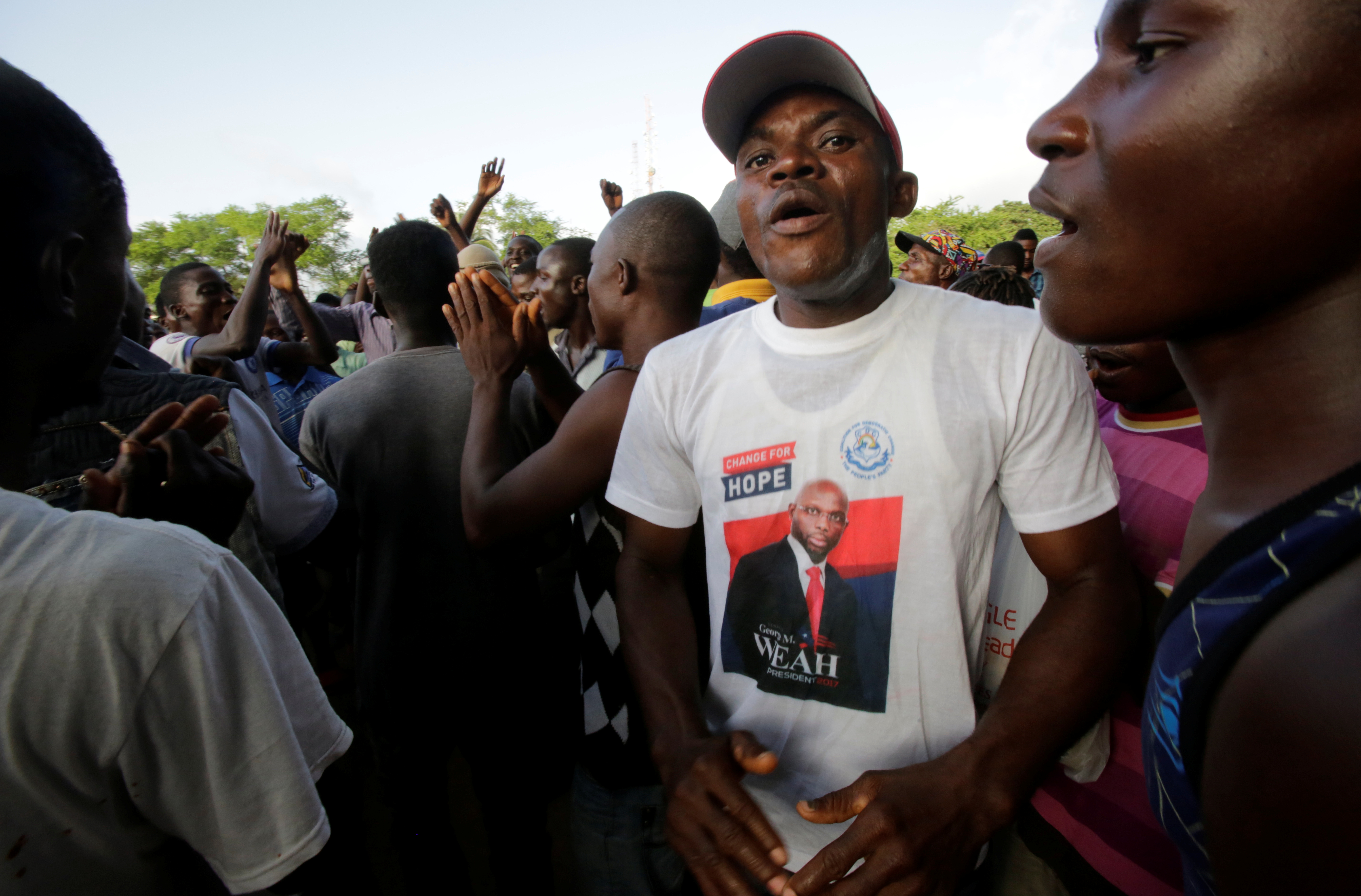Supporters of George Weah, former soccer player and presidential candidate of Congress for Democratic Change (CDC), celebrate after the announcement of the presidential election results on the radio, in Monrovia, Liberia October 19, 2017. REUTERS/Thierry Gouegnon - RC1589A09A80