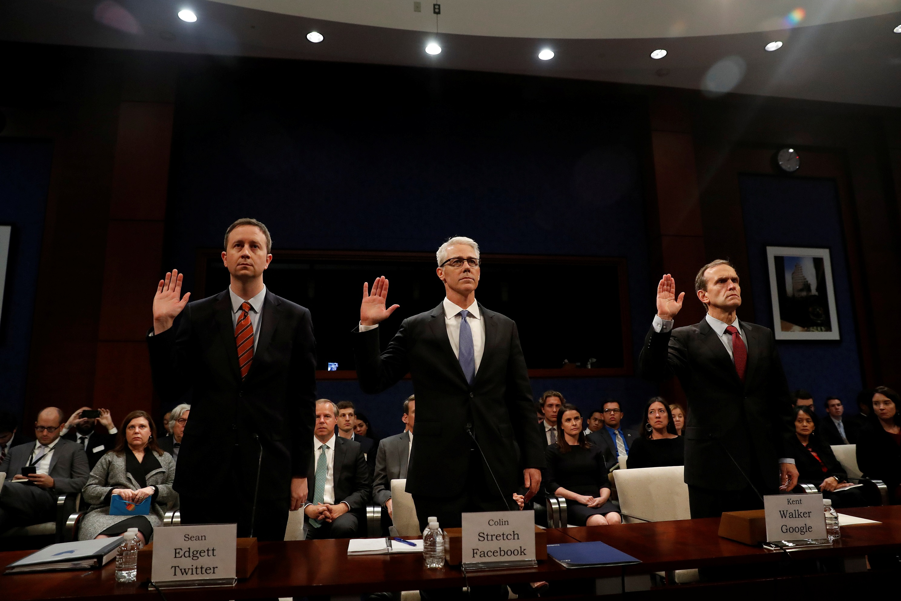 Twitter Acting General Counsel Sean Edgett, Facebook General Counsel Colin Stretch and Google Senior Vice President and General Counsel Kent Walker are sworn in before the House Intelligence Committee to answer questions related to Russian use of social media to influence U.S. elections, on Capitol Hill in Washington, U.S., November 1, 2017. REUTERS/Aaron P. Bernstein - RC16D2B0FBC0