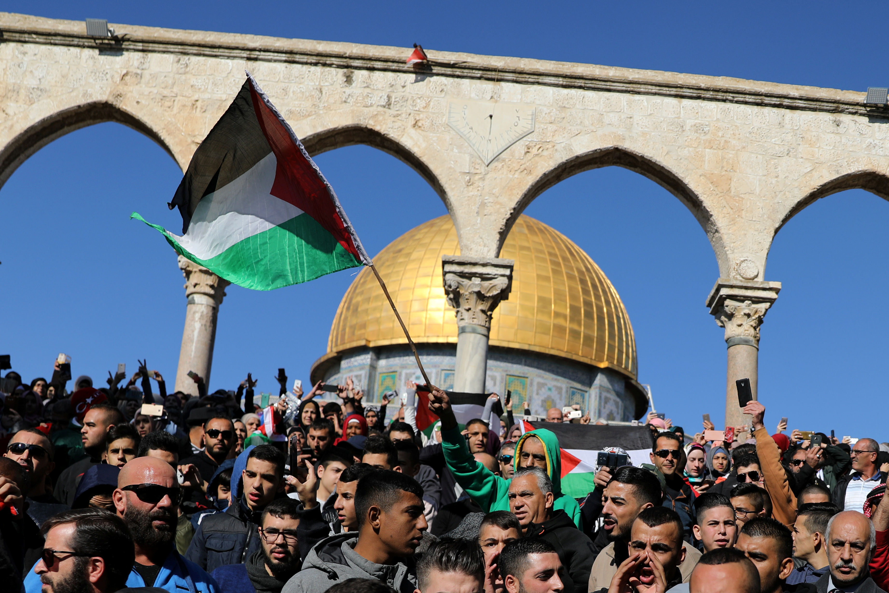 "Worshippers hold Palestinian flags after Friday prayers on the compound known to Muslims as Noble Sanctuary and to Jews as Temple Mount in Jerusalem's Old City, as Palestinians call for a ""day of rage"" in response to U.S. President Donald Trump's recognition of Jerusalem as Israel's capital December 8, 2017. REUTERS/Ammar Awad - RC1922868190"
