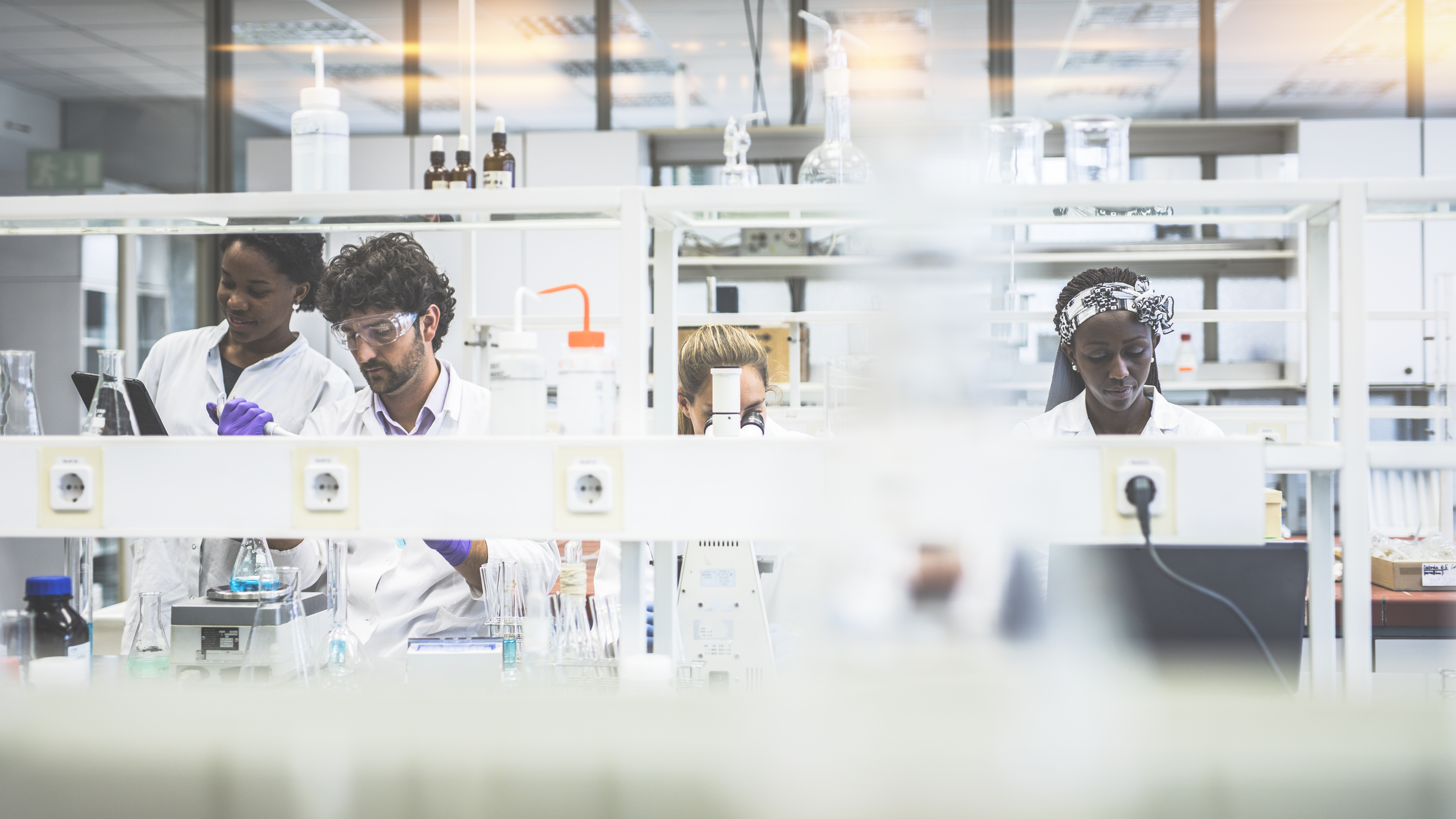 A group of scientists working in the laboratory