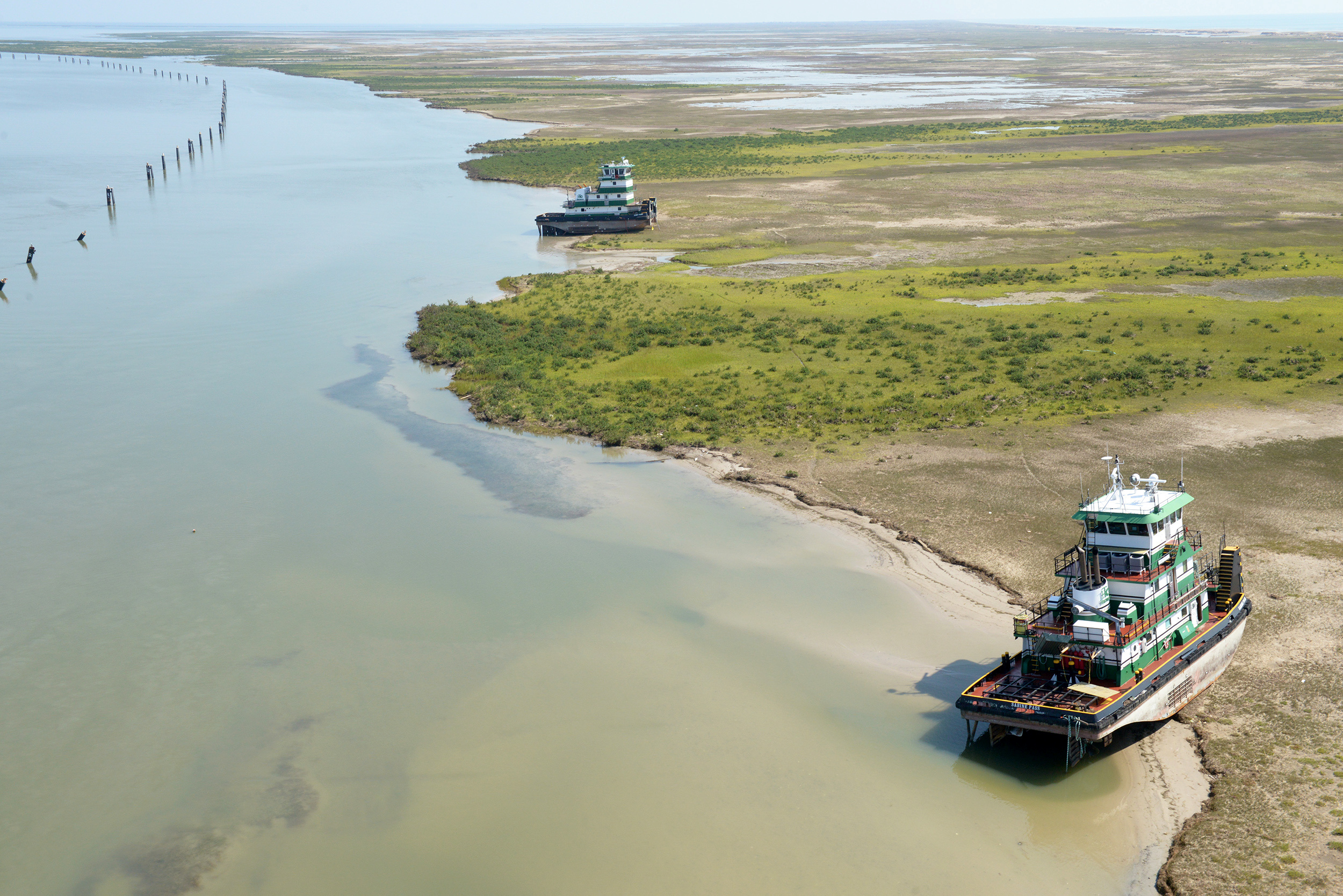Vessels rest on the bank after running aground during Hurricane Harvey.