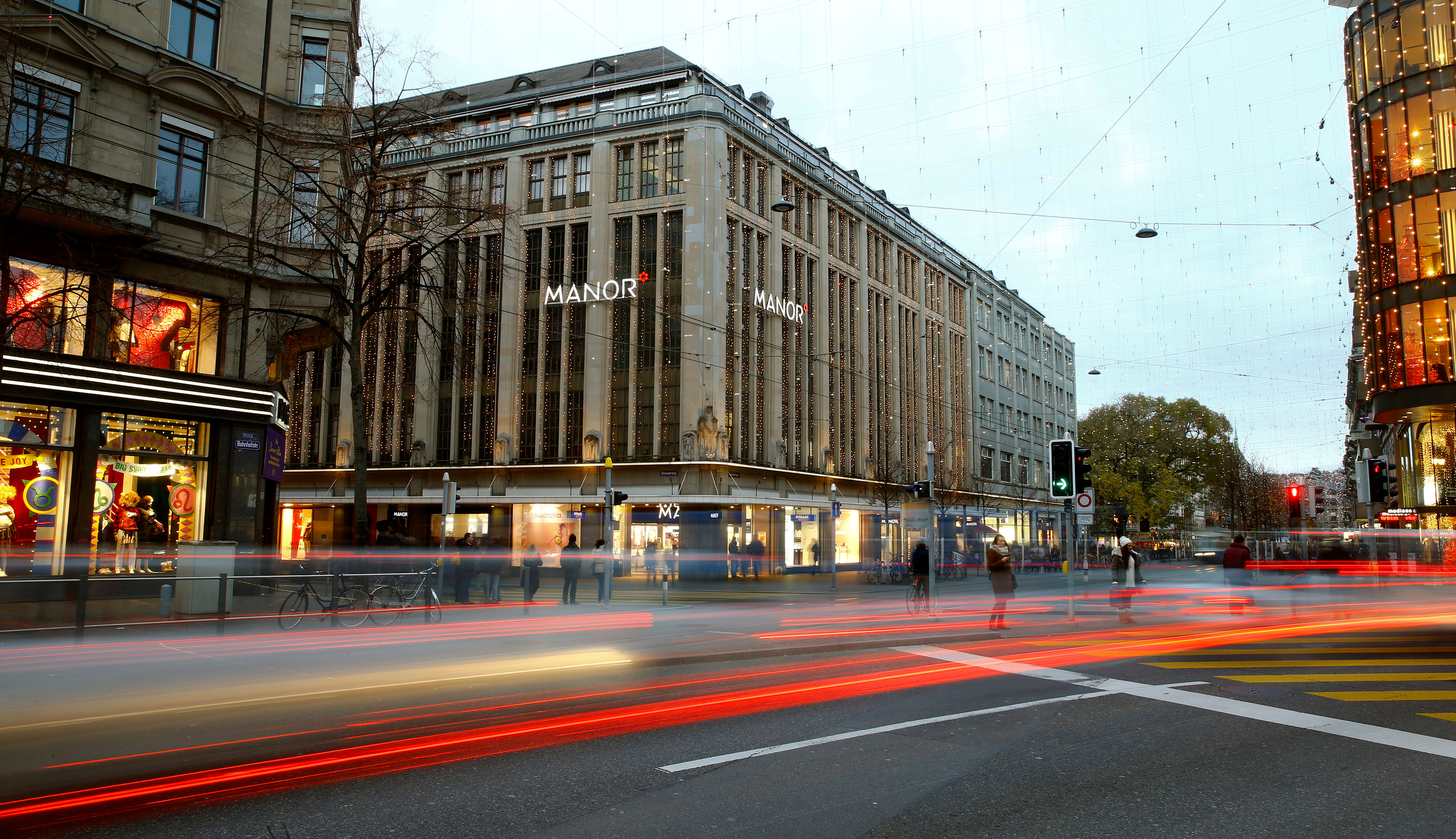 A longtime exposure shows traffic flowing in front of the Manor department store at the Bahnhofstrasse shopping street