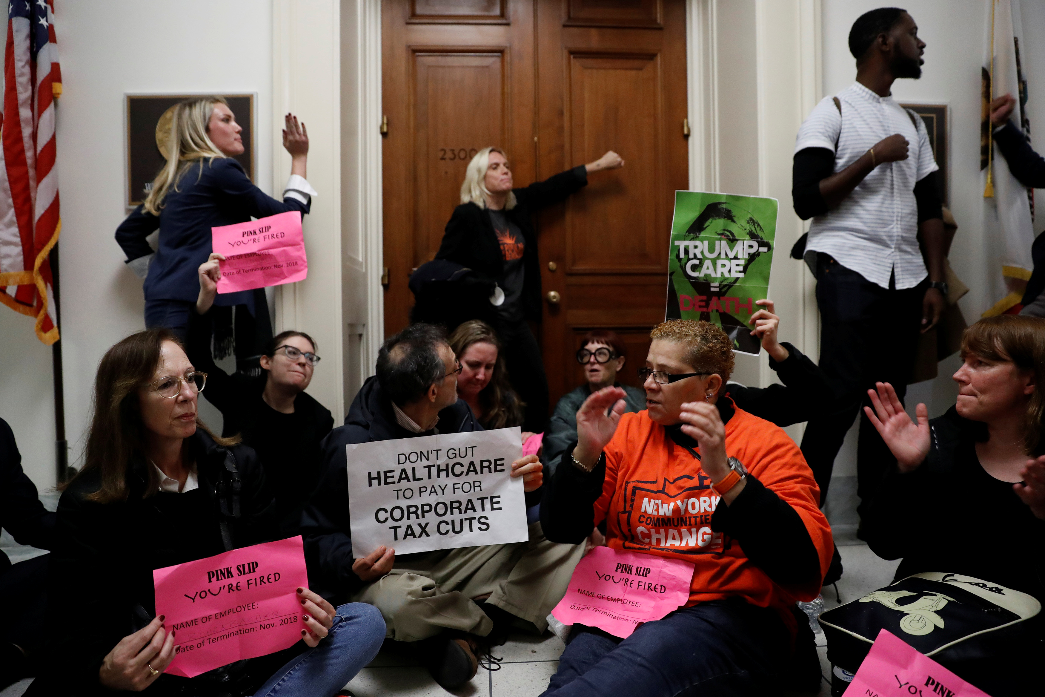 Demonstrators protest against the tax bill.