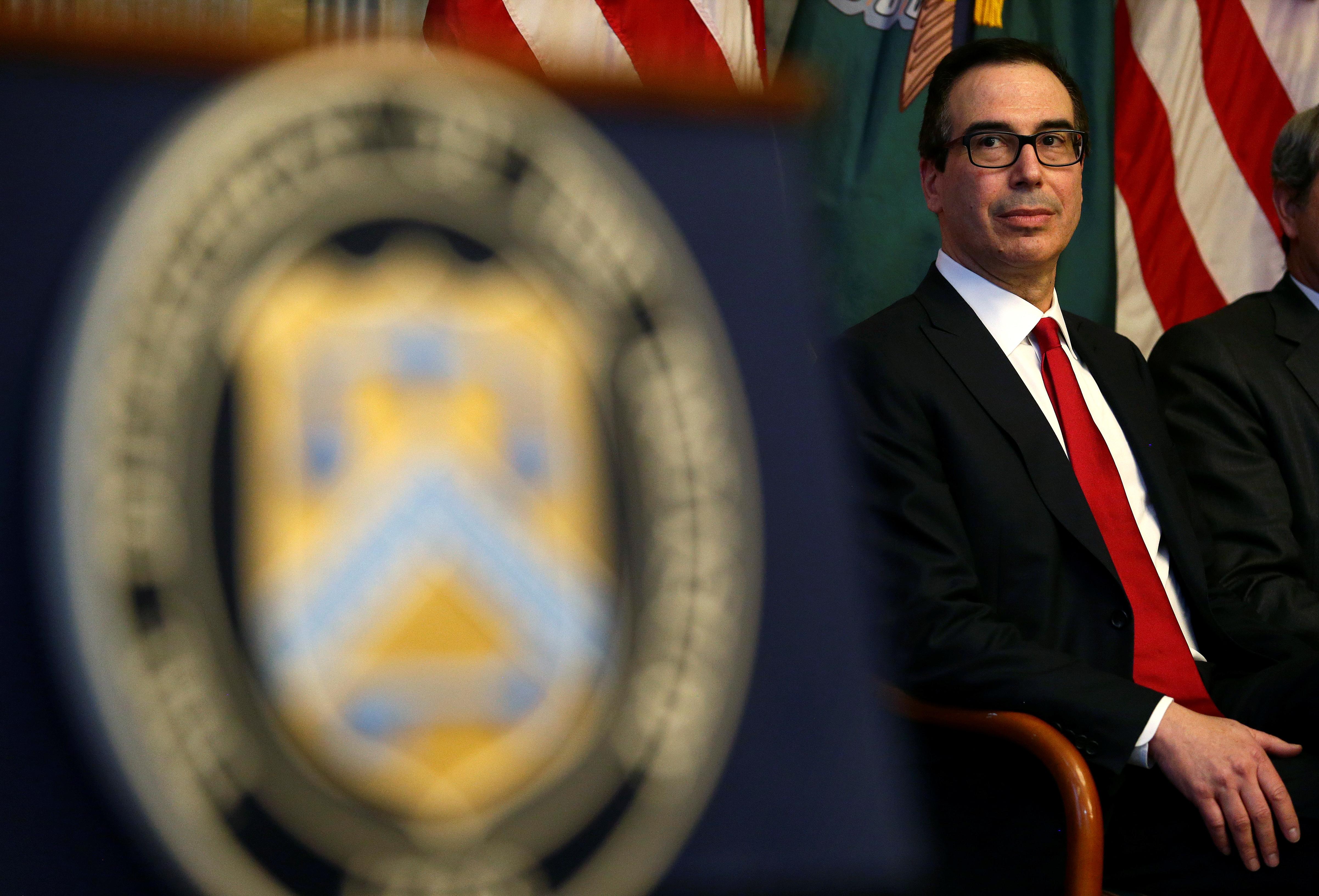 U.S. Secretary of the Treasury Steven Mnuchin sits after swearing-in Joseph M. Otting as Comptroller of the Currency in Washington, U.S., November 27, 2017.   REUTERS/Joshua Roberts - RC1487FF4710