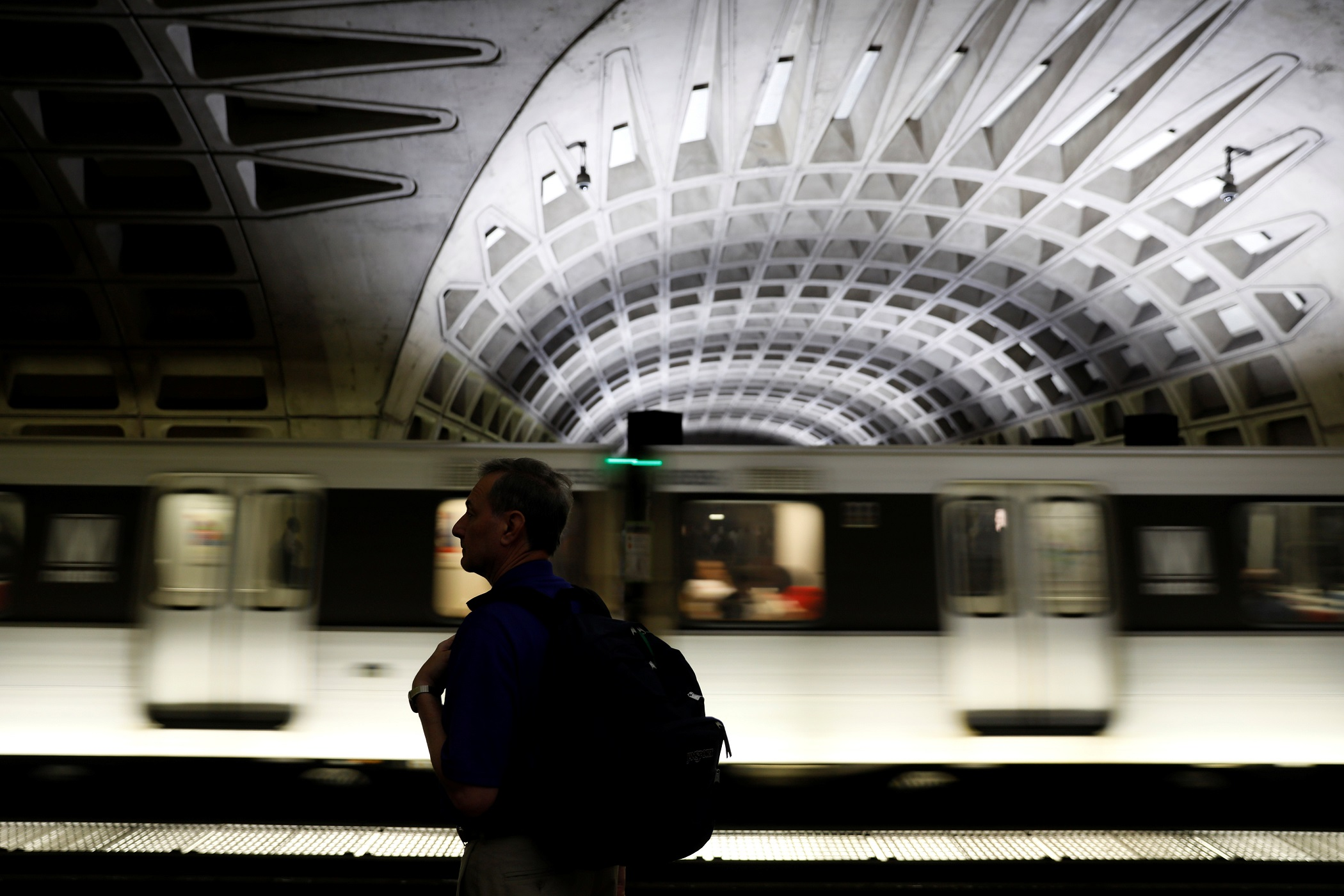 A commuter waits for a subway train in the L'Enfant Plaza subway station before the start of the morning rush in Washington, U.S. June 12, 2017.  REUTERS/Jonathan Ernst - RC15871F5DF0