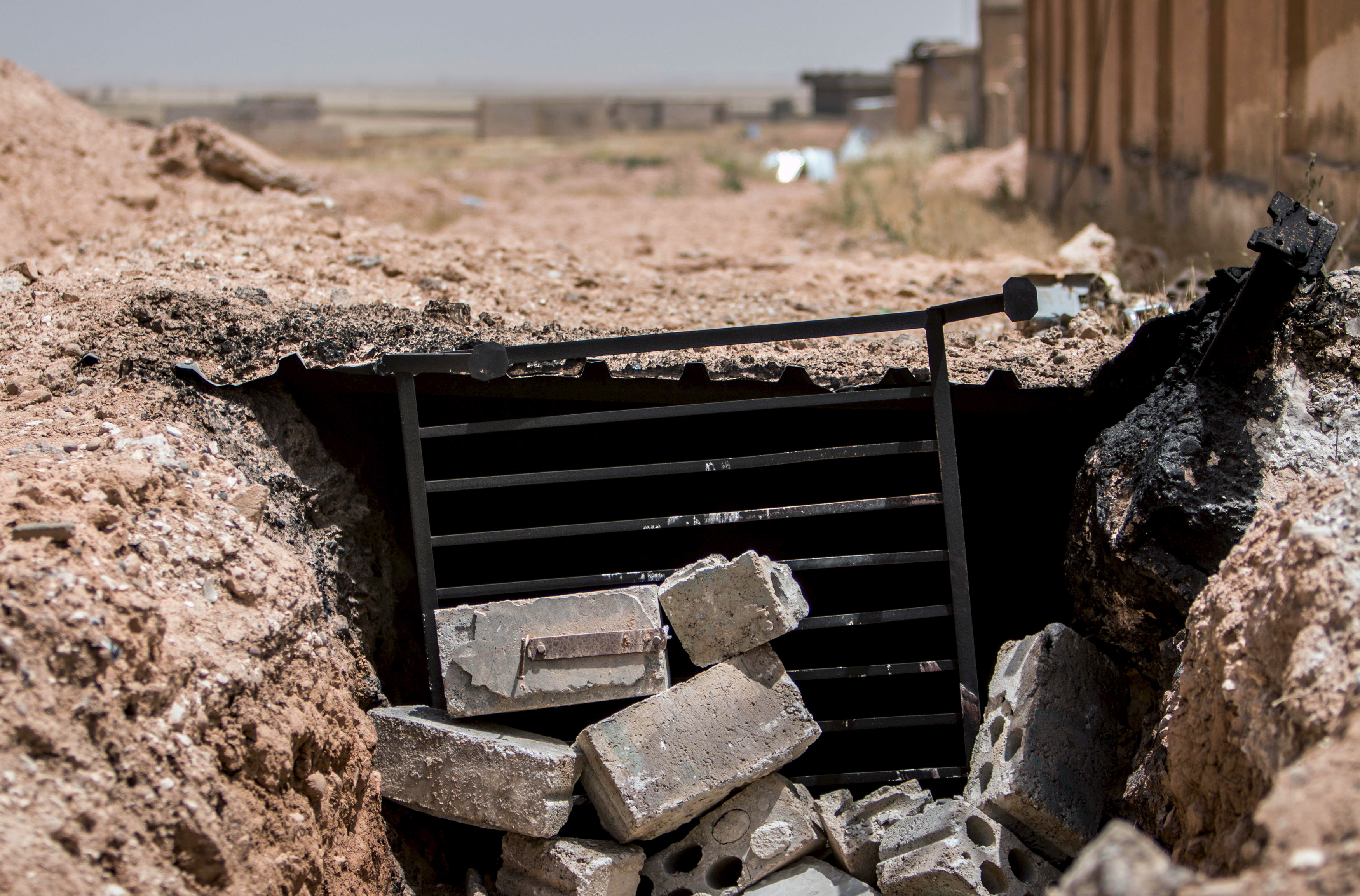 A view shows the entrance of a tunnel used by Islamic State fighters as a shelter in the town of al-Mabroukah after the Kurdish People's Protection Units (YPG) they took control of the area May 28, 2015. A Syrian Kurdish militia has captured a town from Islamic State in the northeast, a group monitoring the war reported on Wednesday, compounding recent losses for the jihadists in a strategic corner of Syria. The capture of the town of al-Mabroukah by the YPG militia opens the road for its forces to advance towards the Islamic State's stronghold in Raqqa province, the Syrian Observatory for Human Rights reported. REUTERS/Rodi Said - GF10000110254