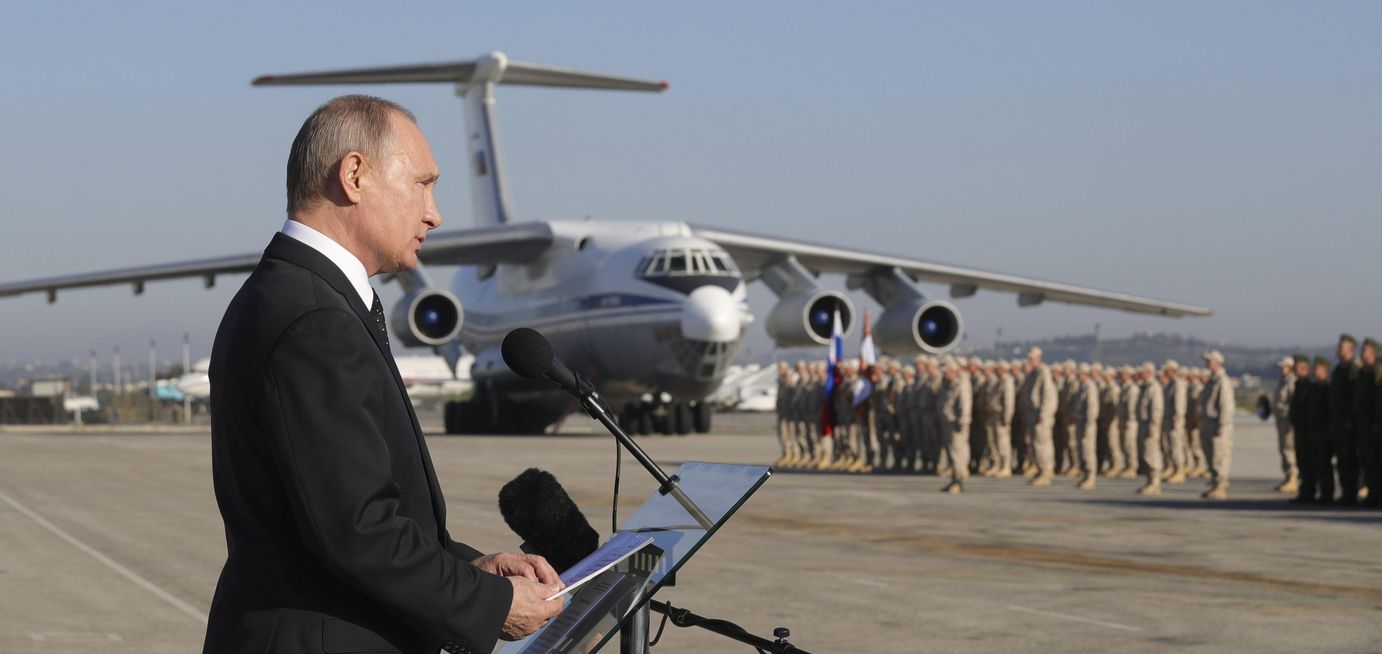 FILE PHOTO: Russian President Vladimir Putin addresses servicemen as he visits the Hmeymim air base in Latakia Province, Syria December 11, 2017. Sputnik/Mikhail Klimentyev/Sputnik via REUTERS ATTENTION EDITORS - THIS IMAGE WAS PROVIDED BY A THIRD PARTY/File Photo - RC13F85C4140