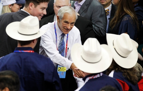 U.S. Republican presidential candidate Rep. Ron Paul (R-TX) shakes hands with fellow members of the Texas delegation during the second session of the 2012 Republican National Convention in Tampa, Florida August 28, 2012. REUTERS/Joe Skipper (UNITED STATES - Tags: POLITICS ELECTIONS) - TM3E88S16D401