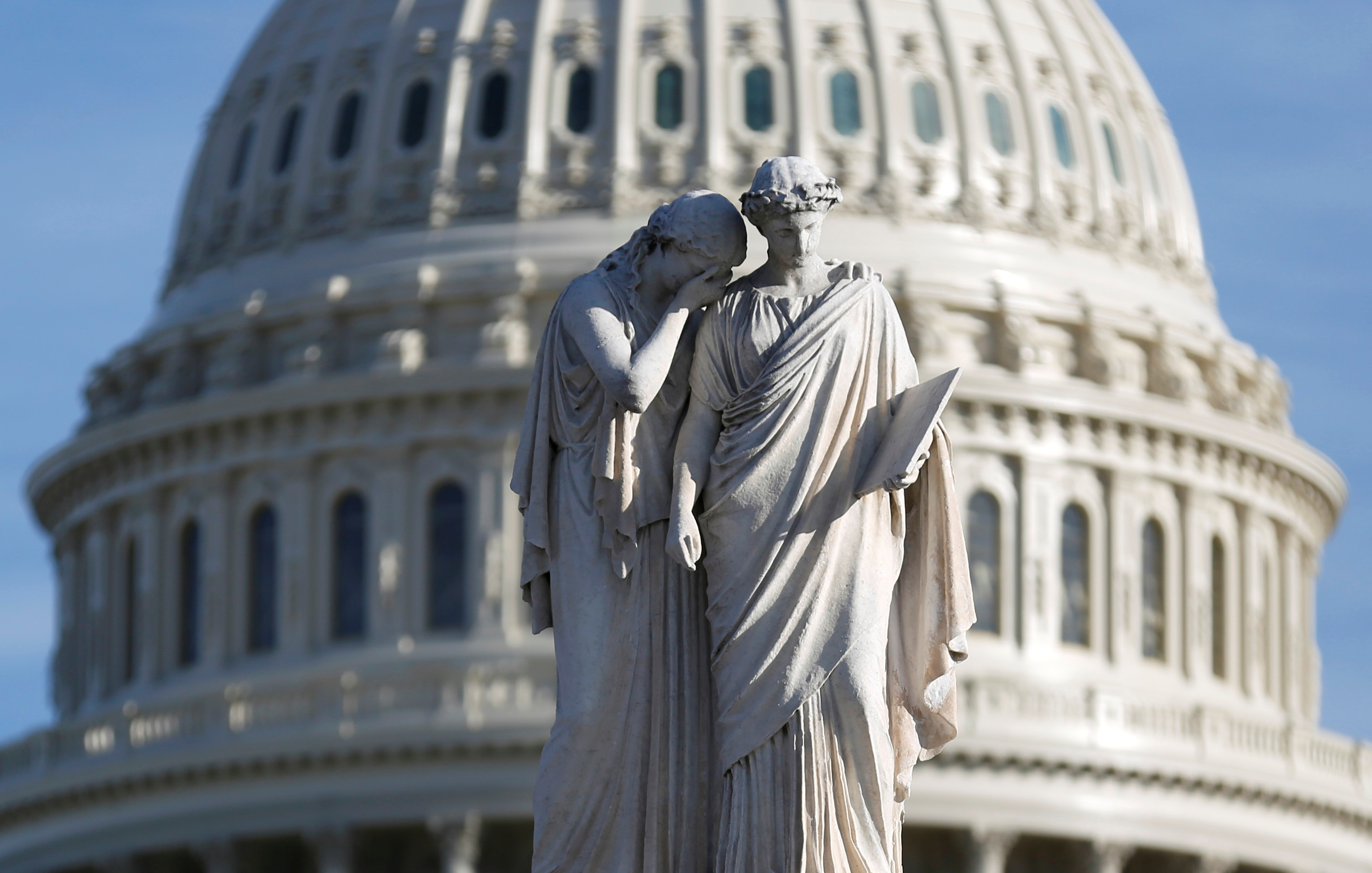 The figures of Grief and History stand on top of the Peace Statue near the U.S. Capitol after President Donald Trump and the U.S. Congress failed to reach a deal on funding for federal agencies in Washington, U.S., January 20, 2018.      REUTERS/Joshua Roberts - RC1F1DB11260