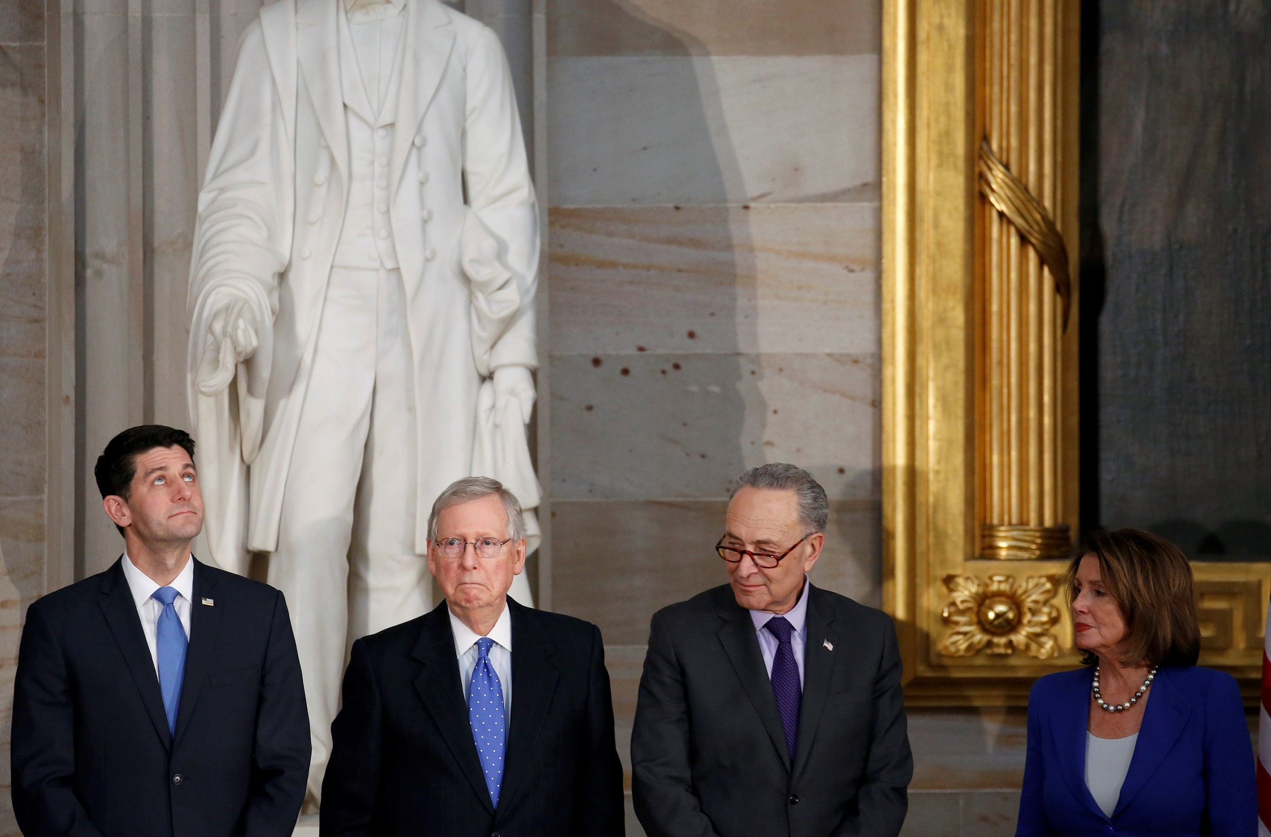 Speaker of the House Paul Ryan (R-WI), Senate Majority Leader Mitch McConnell (R-KY), Senate Minority Leader Chuck Schumer (D-NY) and House Minority Leader Nancy Pelosi (D-CA) stand during a Congressional Gold Medal ceremony honoring former Senate majority leader Bob Dole (R-KS) on Capitol Hill in Washington, U.S., January 17, 2018. REUTERS/Joshua Roberts - RC154A11A3F0