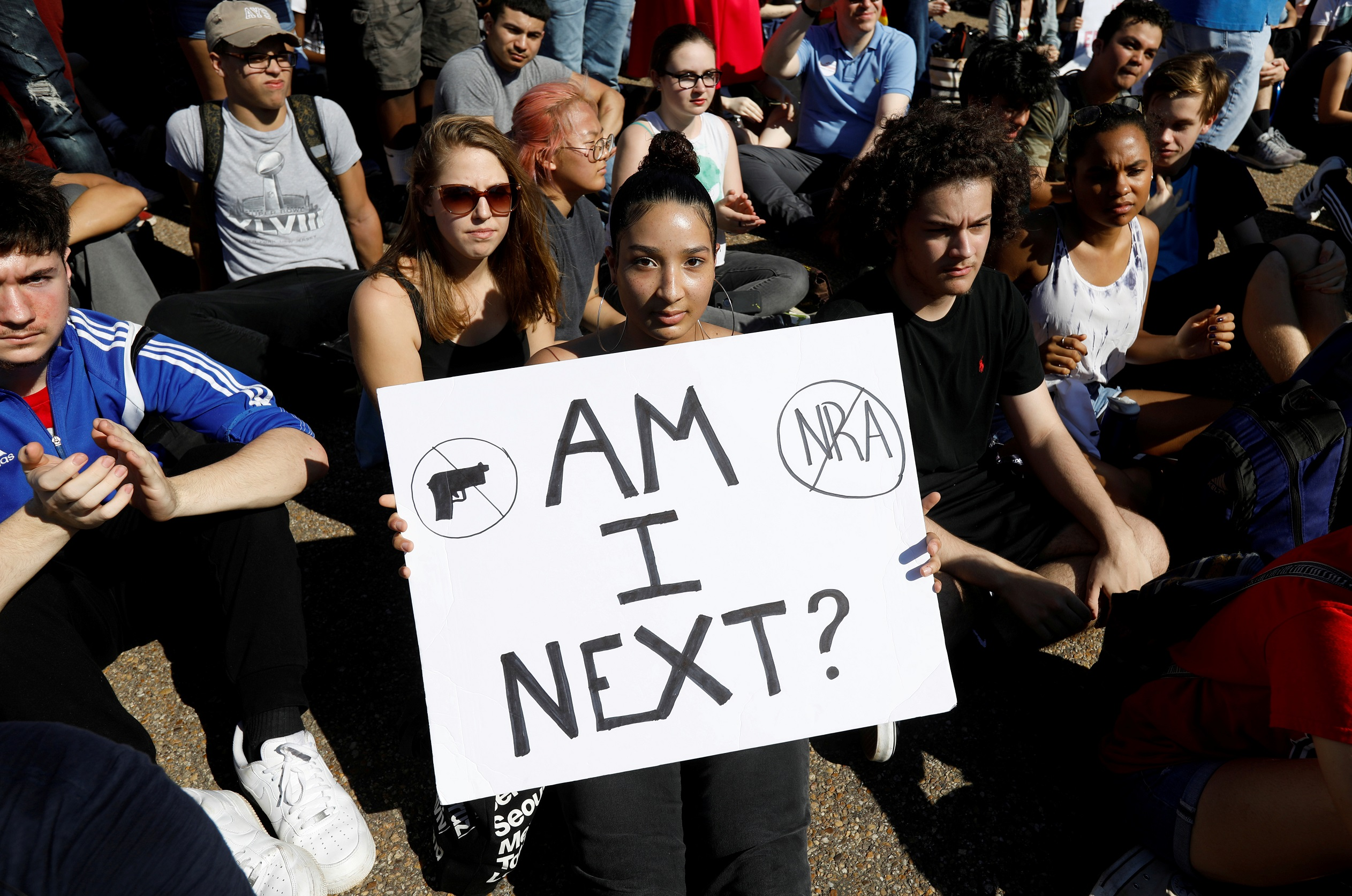 Students who walked out of their Montgomery County, Maryland, schools protest against gun violence in front of the White House in Washington, U.S., February 21,  2018.  REUTERS/Kevin Lamarque     TPX IMAGES OF THE DAY - RC195C982280