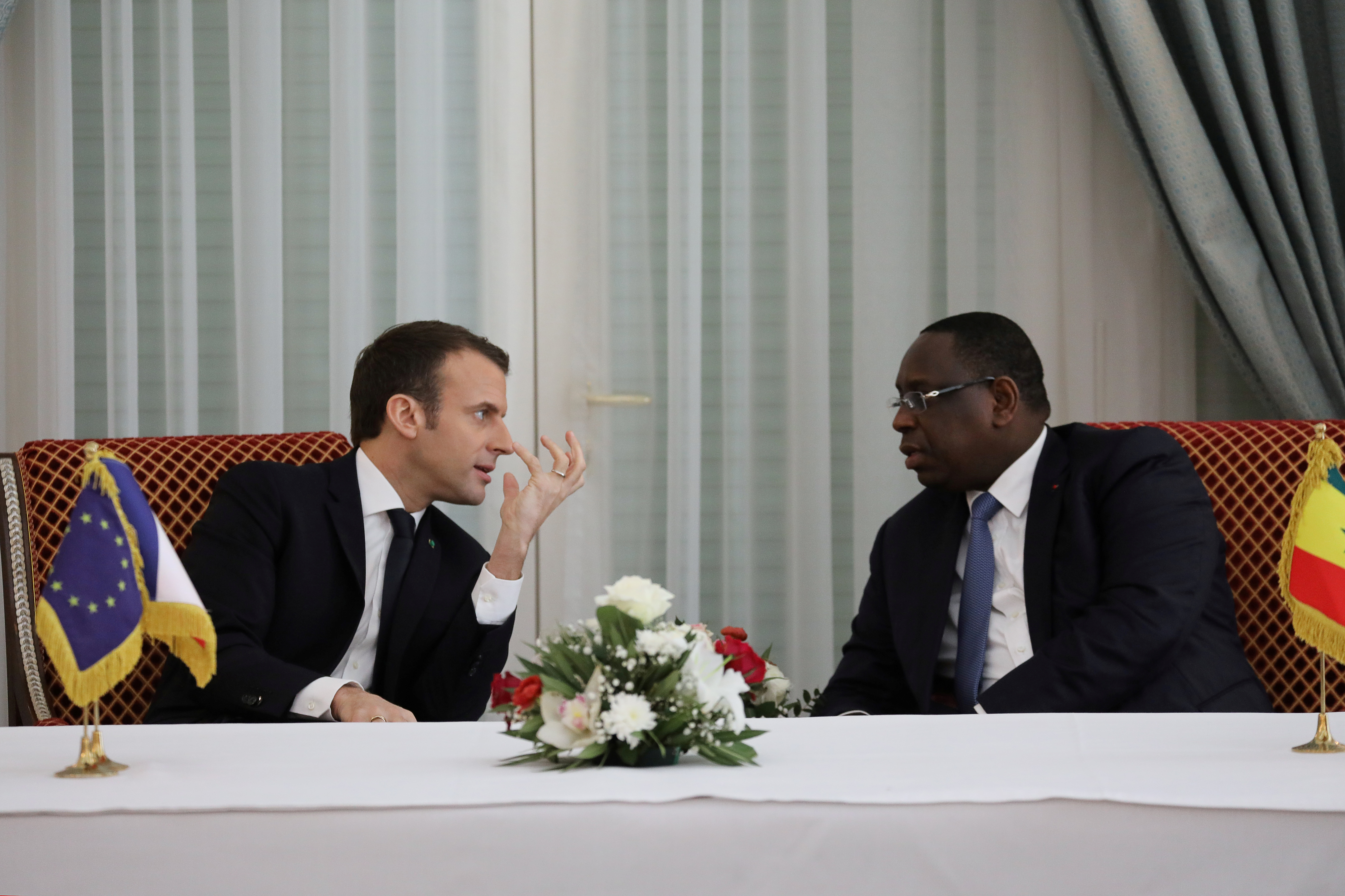 Senegalese President Macky Sall and French President Emmanuel Macron talk during an agreement signing ceremony at the presidential palace in Dakar, Senegal, February 2, 2018.      REUTERS/Ludovic Marin/Pool - RC1282C70620