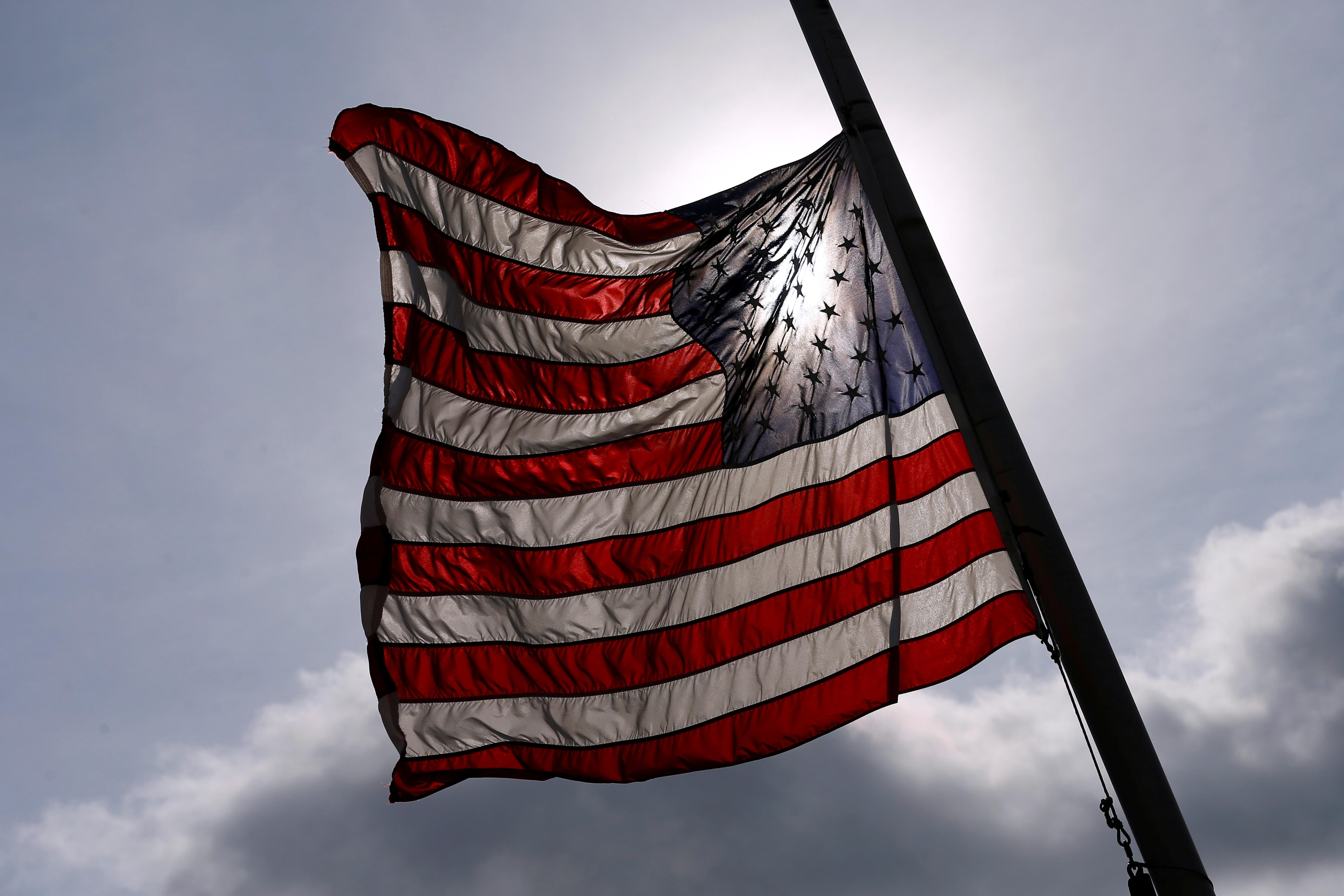 An American flag is seen at half-mast.
