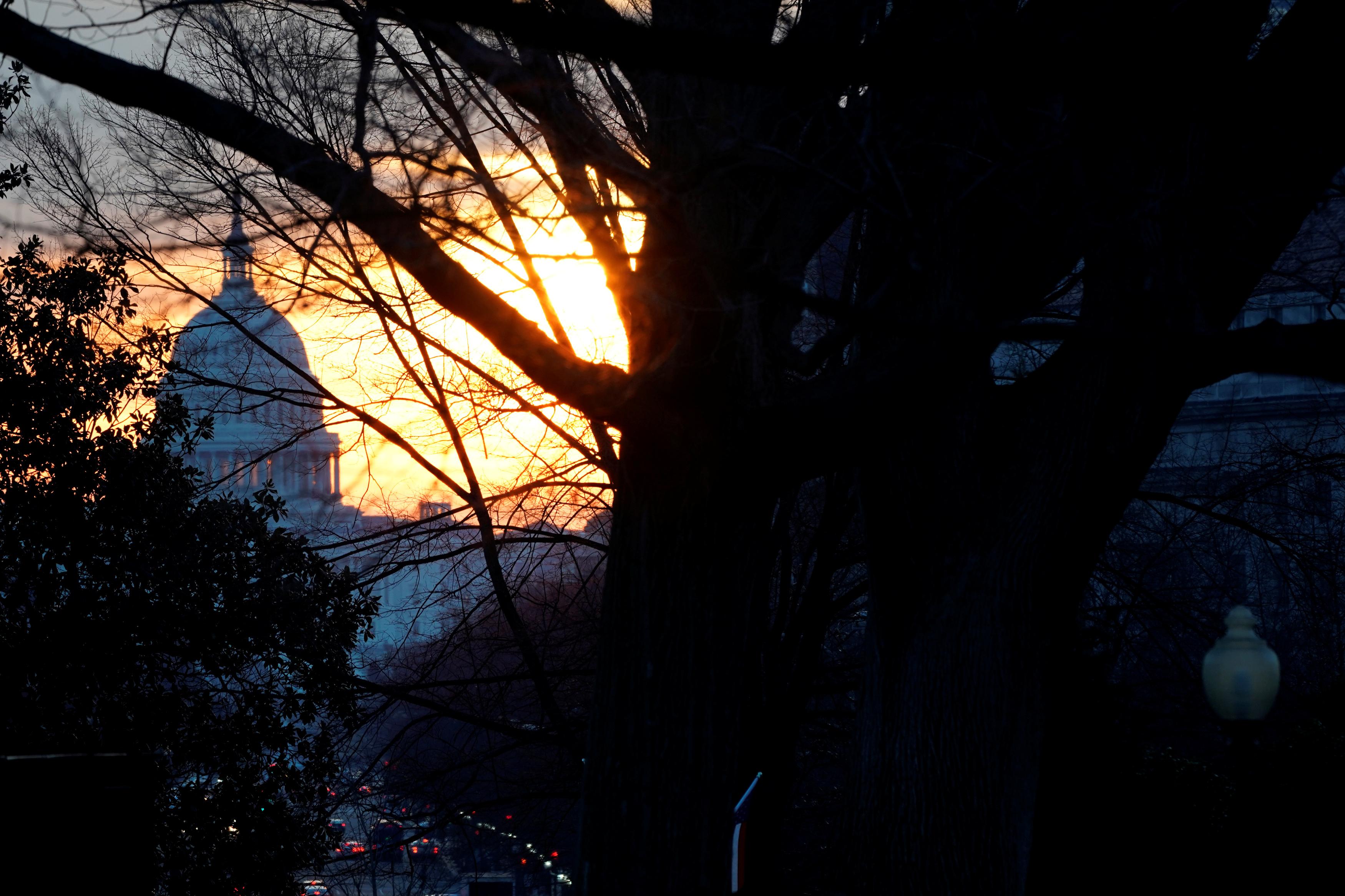 The sun rises over the U.S. Capitol.