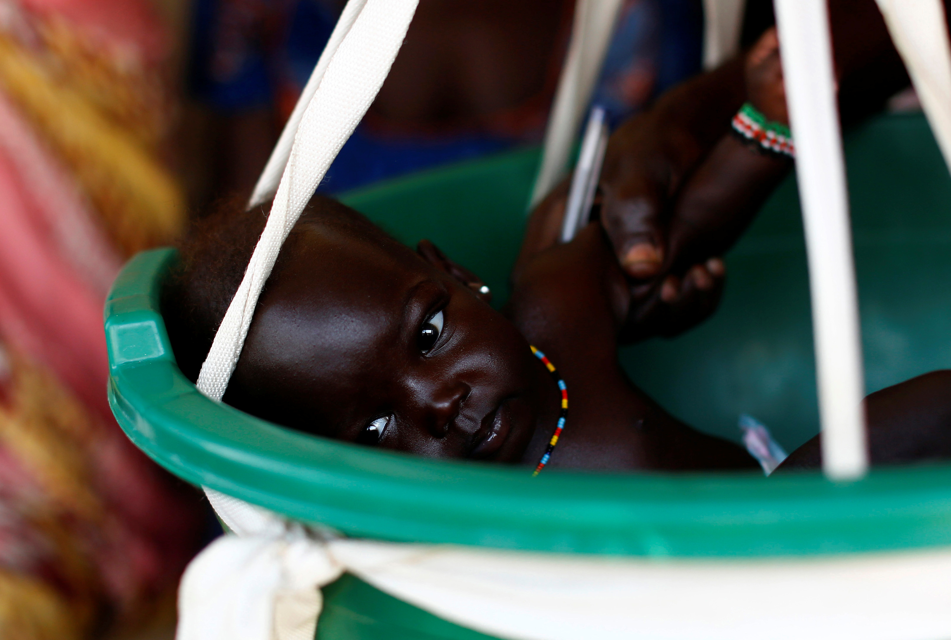 A baby is weighted on a scale in a health clinic in the capital Juba, South Sudan, January 23, 2017. Picture taken January 23, 2017. REUTERS/Siegfried Modola - RC157C1D0FF0