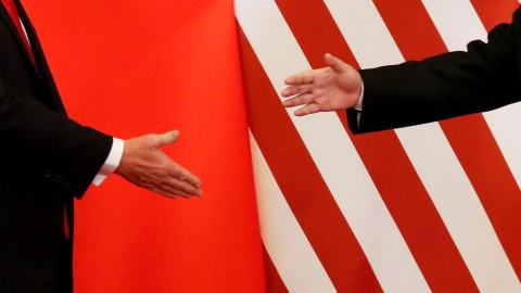 "U.S. President Donald Trump and China's President Xi Jinping shake hands after making joint statements at the Great Hall of the People in Beijing, China, November 9, 2017. Damir Sagolj: ""It's one of those ""how to make a better or at least different shot when two presidents shake hands several times a day, several days in row"". If I'm not mistaken in calculation, presidents Xi Jinping of China and Donald Trump of the U.S. shook their hands at least six times in events I covered during Trump's recent visit to China. I would imagine there were some more handshakes I haven't seen but other photographers did. And they all look similar - two big men, smiling and heartily greeting each other until everyone gets their shot. But then there is always something that can make it special - in this case the background made of U.S. and Chinese flags. They shook hands twice in front of it, and the first time it didn't work for me. The second time I positioned myself lower and centrally, and used the longest lens I have to capture only hands reaching for a handshake."" REUTERS/Damir Sagolj/File Photo  SEARCH ""POY TRUMP"" FOR THIS STORY. SEARCH ""REUTERS POY"" FOR ALL BEST OF 2017 PACKAGES.    TPX IMAGES OF THE DAY - RC1B1E5EF340"