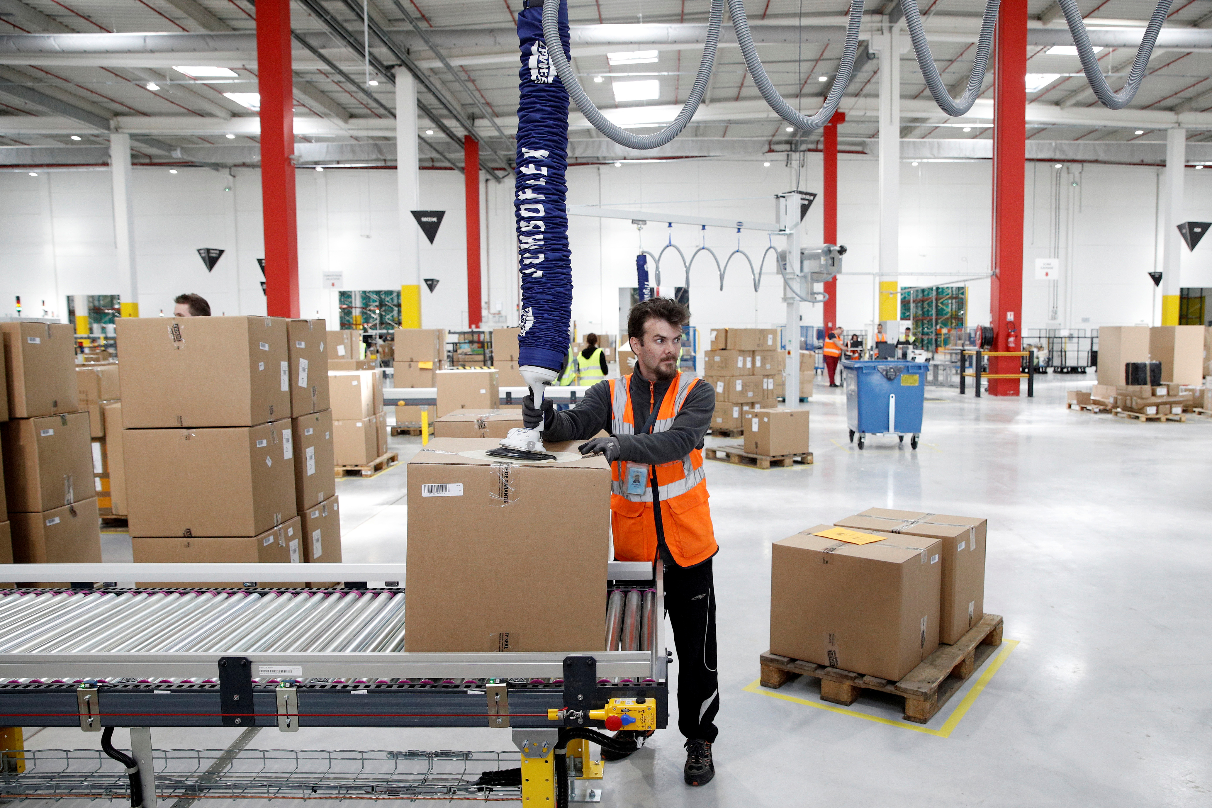 Employees at work at an Amazon factory.