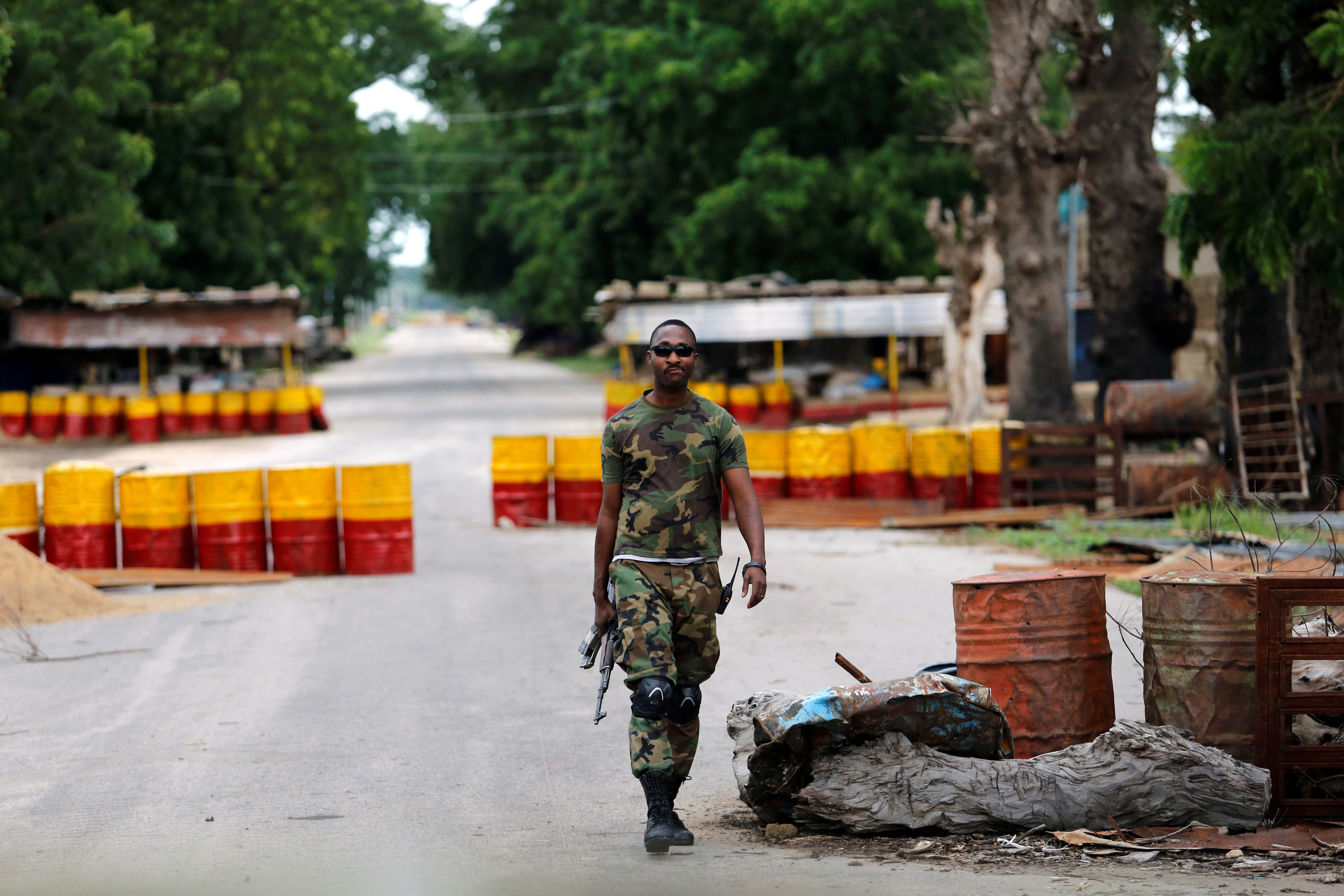 "DATE IMPORTED:September 07, 2016A soldier walks past a checkpoint in Bama, Borno State, Nigeria, August 31, 2016. REUTERS/Afolabi Sotunde SEARCH ""BAMA"" FOR THIS STORY. SEARCH ""WIDER IMAGE"" FOR ALL STORIES. TPX IMAGES OF THE DAY"