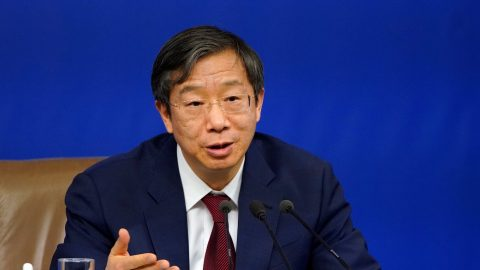 Yi Gang, deputy governor of the People's Bank of China (PBOC), attends a news conference on the sidelines of China's National People's Congress (NPC) in Beijing, China March 9, 2018. Picture taken March 9, 2018. REUTERS/Aly Song - RC179570F590