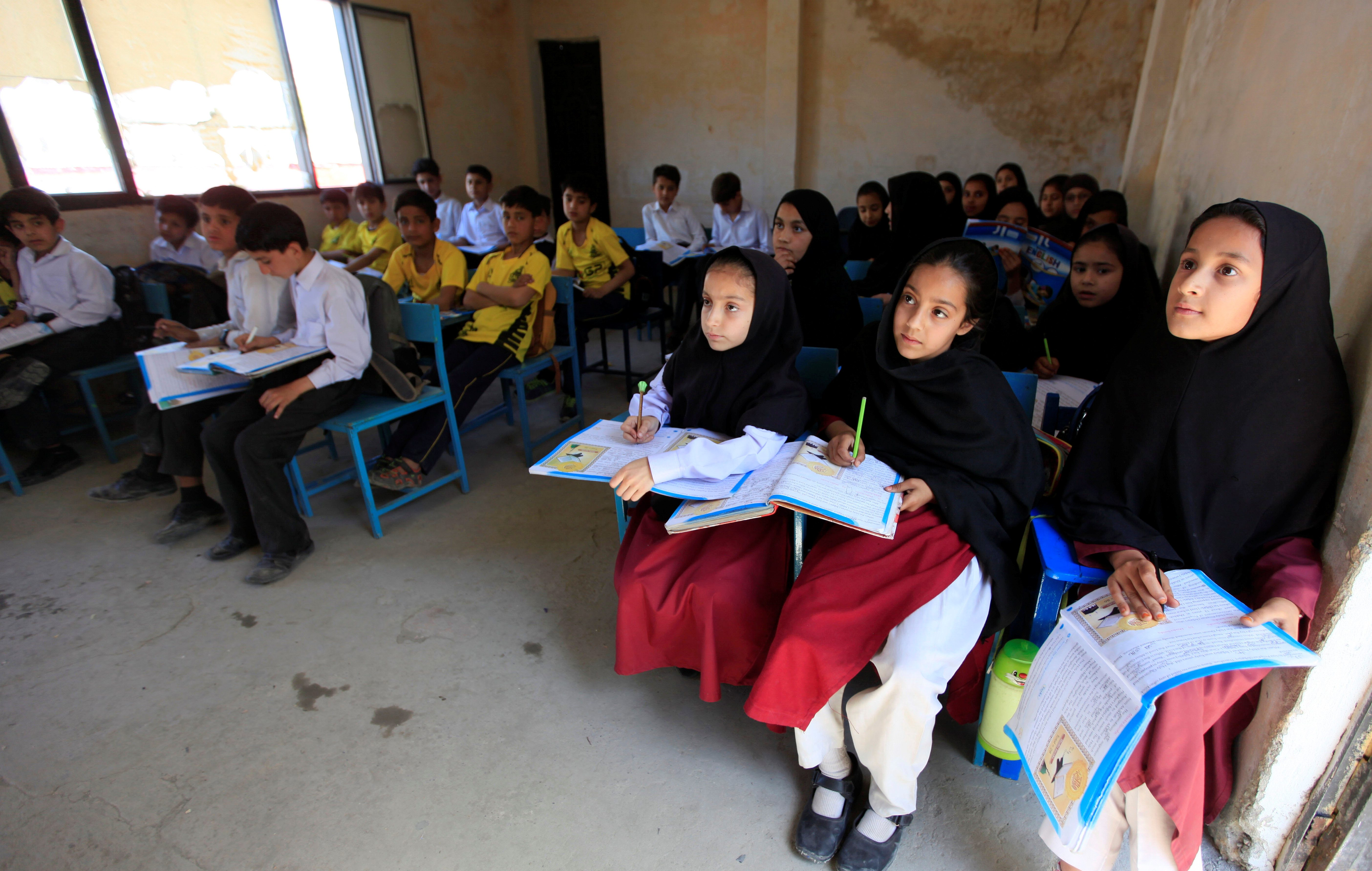 Children attend a class at Khushal school that Nobel Peace Prize laureate Malala Yousafzai used to attend, in her hometown of Mingora in Swat Valley, Pakistan March 30, 2018. REUTERS/Faisal Mahmood - RC16E4045B40