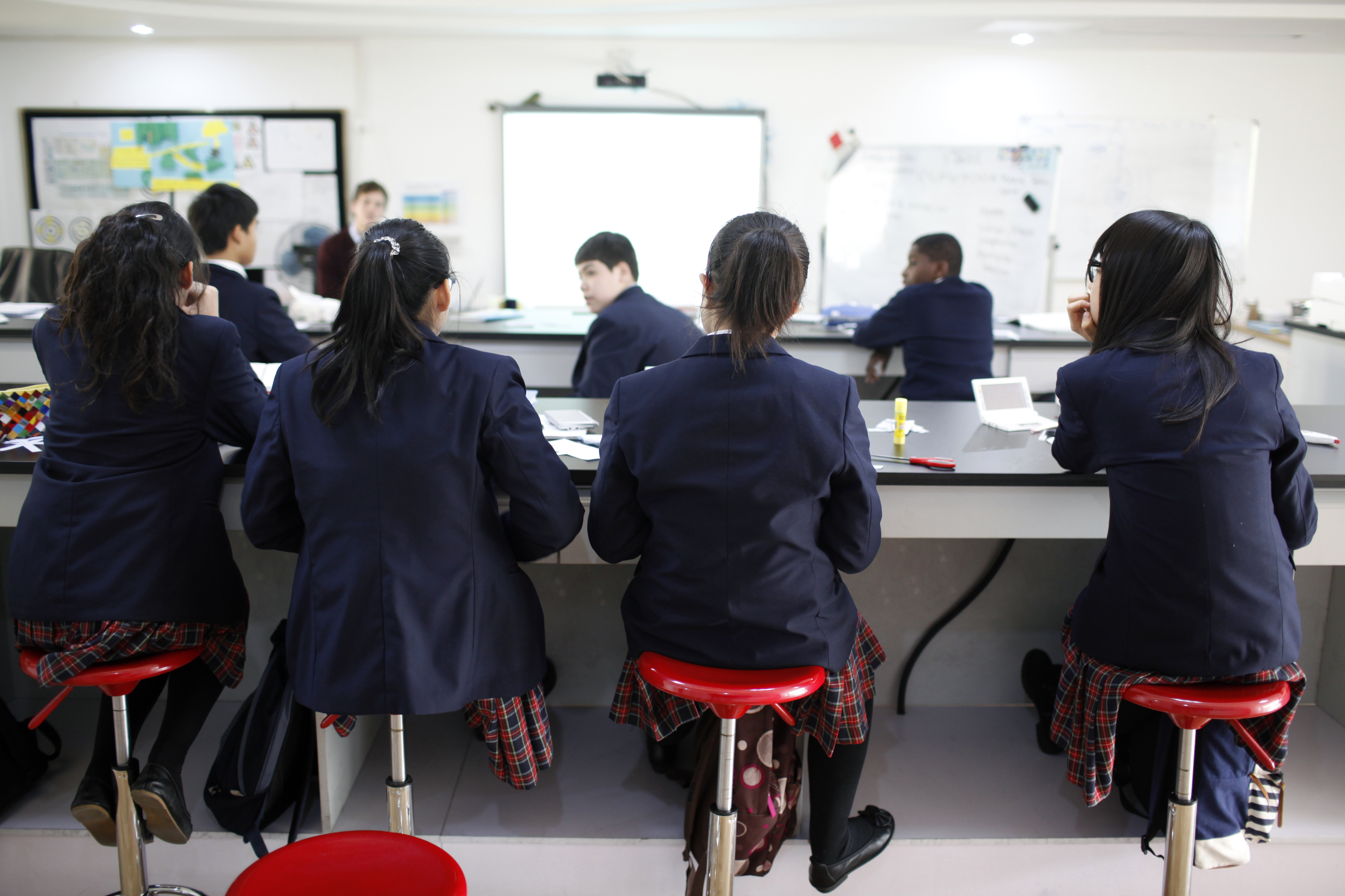 Private school students listen during lecture.