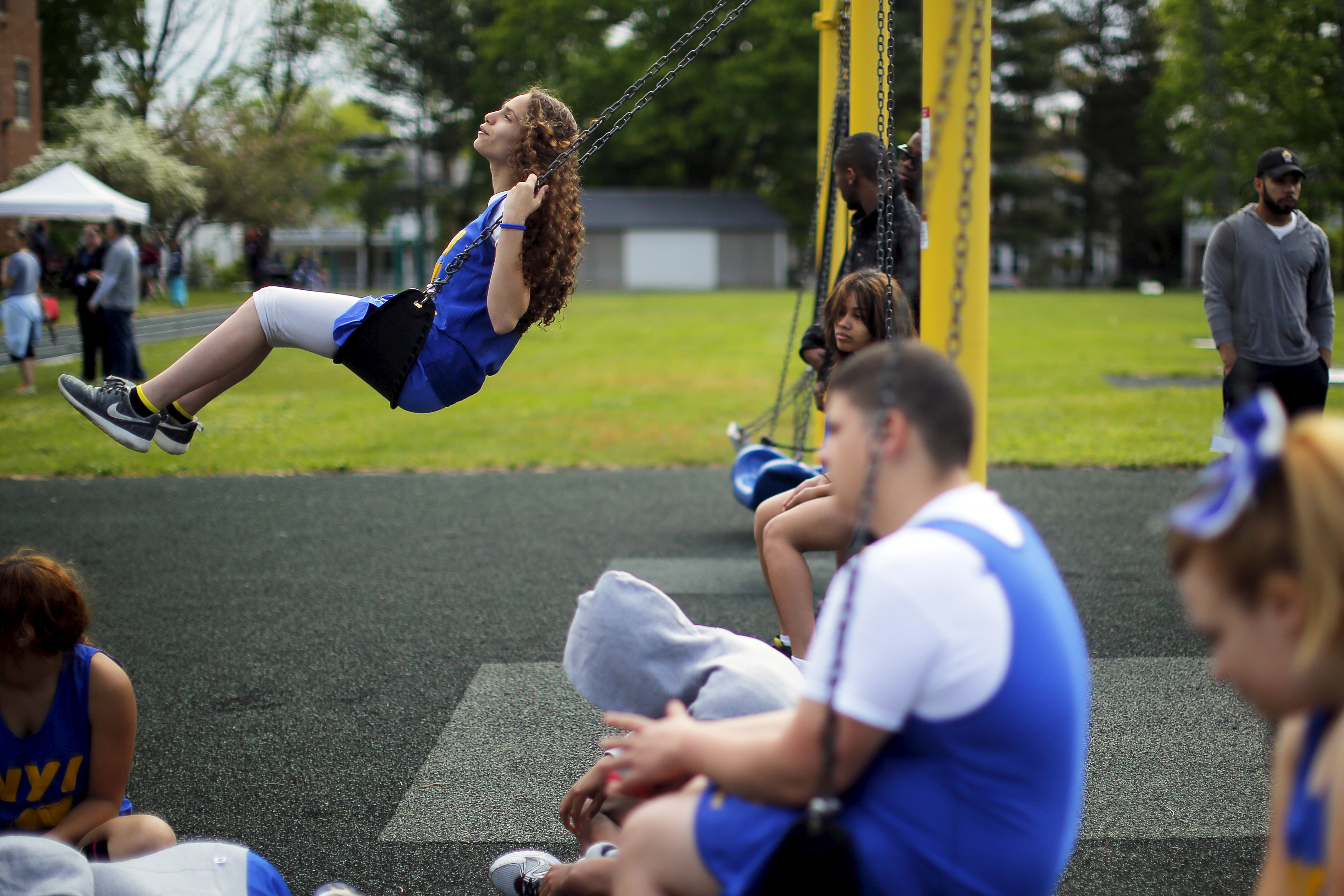 Students from the New York Institute for Special Education swing.