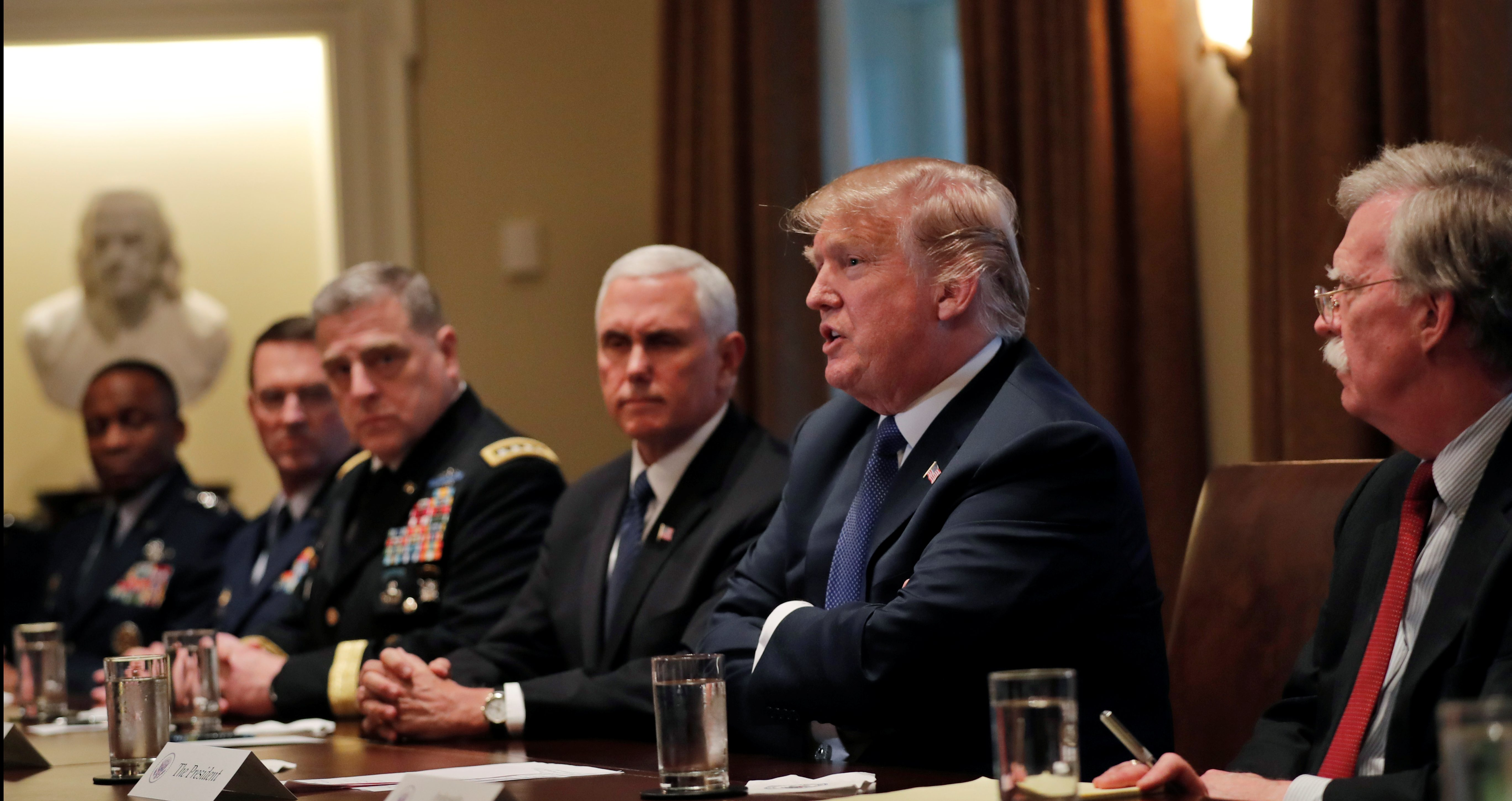 U.S. President Donald Trump receives a briefing from senior military leadership accompanied by Vice President Mike Pence and new National Security Adviser John Bolton.