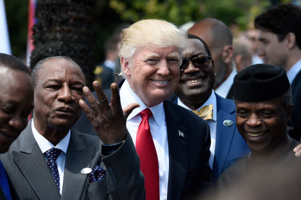 U.S. President Donald Trump shares a laugh with Guinea's President Alpha Conde (L), the Vice President of Nigeria Yemi Osinbajo (R) and other African leaders as they arrive to pose for a family photo with participants of the G7 summit during the Summit of the Heads of State and of Governments of the G7, the group of most industrialized economies, plus the European Union, in Taormina, Sicily, Italy, May 27, 2017. REUTERS/Stephane de Sakutin/Pool - RC1D3FEB60A0