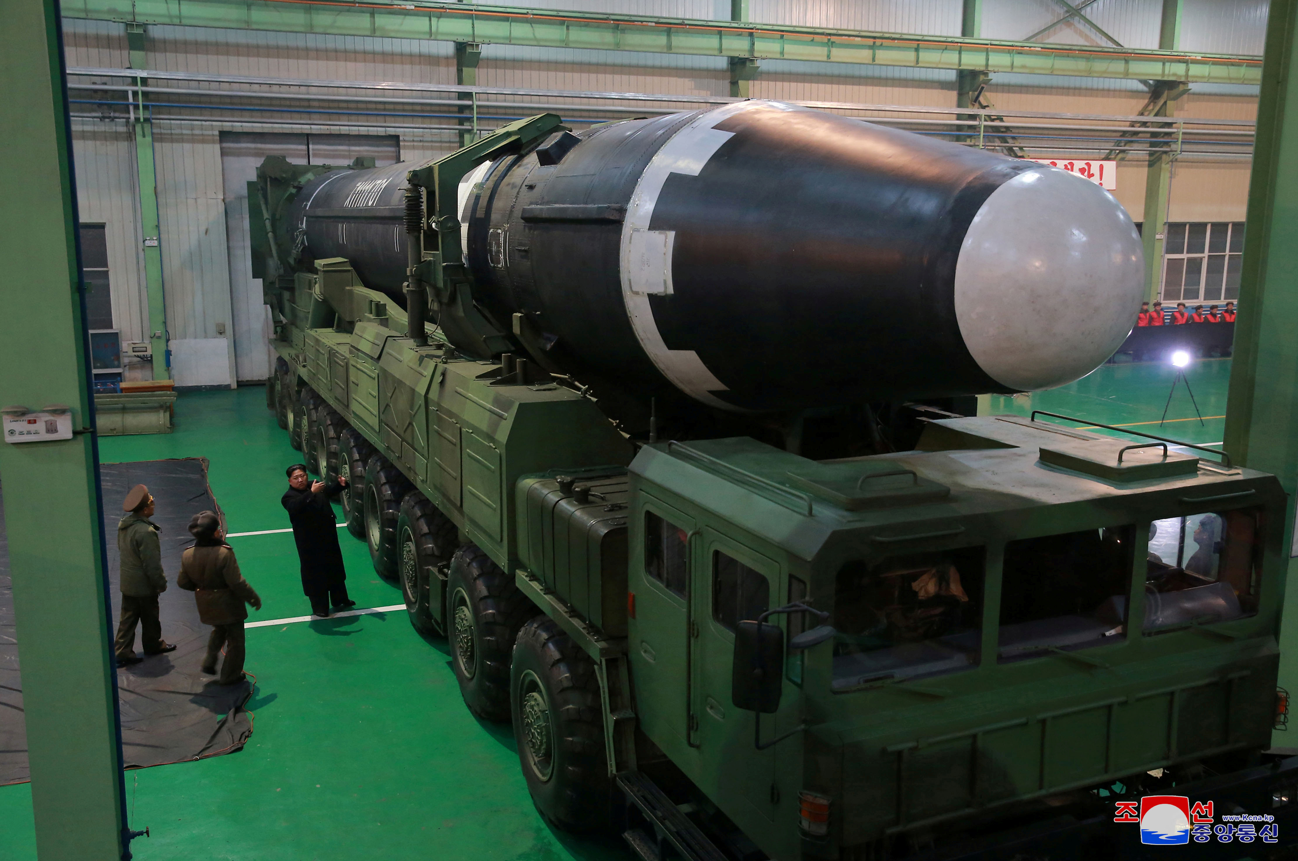 North Korea's leader Kim Jong Un is seen as the newly developed intercontinental ballistic rocket Hwasong-15's test was successfully launched, in this undated photo released by North Korea's Korean Central News Agency (KCNA) in Pyongyang November 30, 2017. REUTERS/KCNA ATTENTION EDITORS - THIS IMAGE WAS PROVIDED BY A THIRD PARTY. REUTERS IS UNABLE TO INDEPENDENTLY VERIFY THIS IMAGE. SOUTH KOREA OUT. NO THIRD PARTY SALES. NOT FOR USE BY REUTERS THIRD PARTY DISTRIBUTORS     TPX IMAGES OF THE DAY - RC1D9D9D59A0