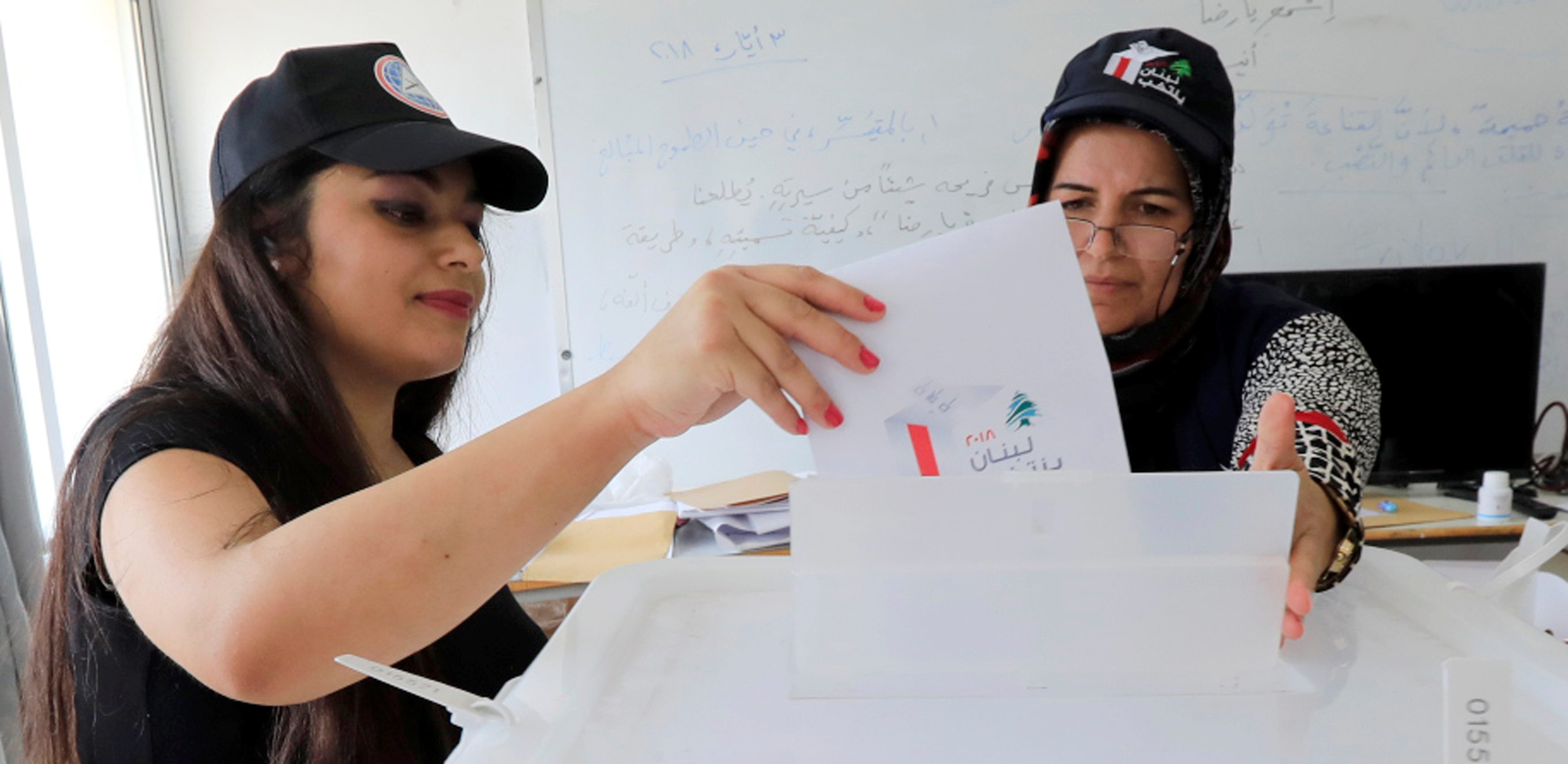A woman casts her vote at a polling station during the parliamentary election, in Aley, Lebanon, May 6, 2018. REUTERS/ Jamal Saidi - RC1D4073C030