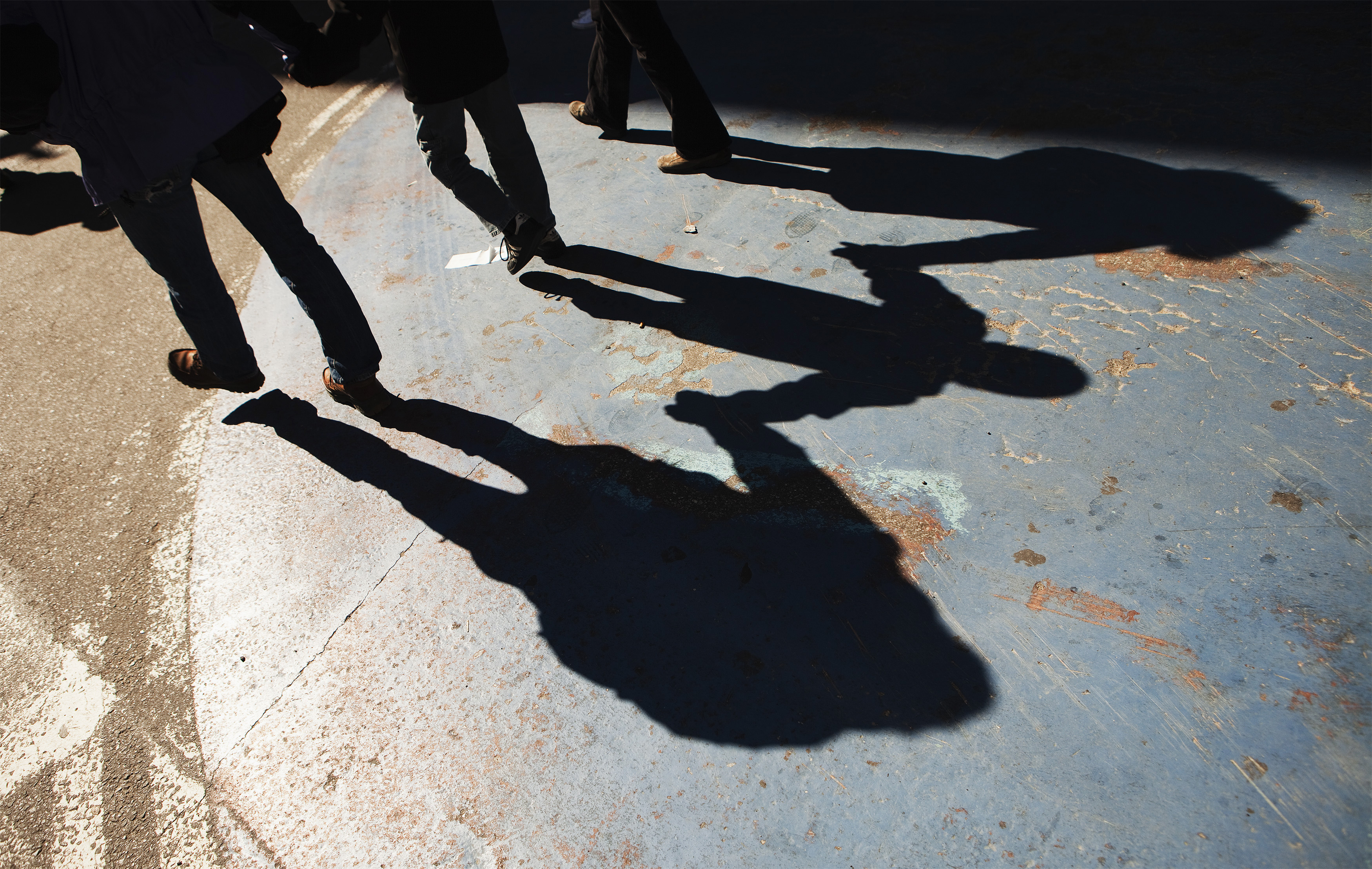 A family hold hands as they walk through Times Square during a warm winter day in New York March 6, 2012. REUTERS/Lucas Jackson (UNITED STATES - Tags: ENVIRONMENT SOCIETY) - GM1E8370EKC01
