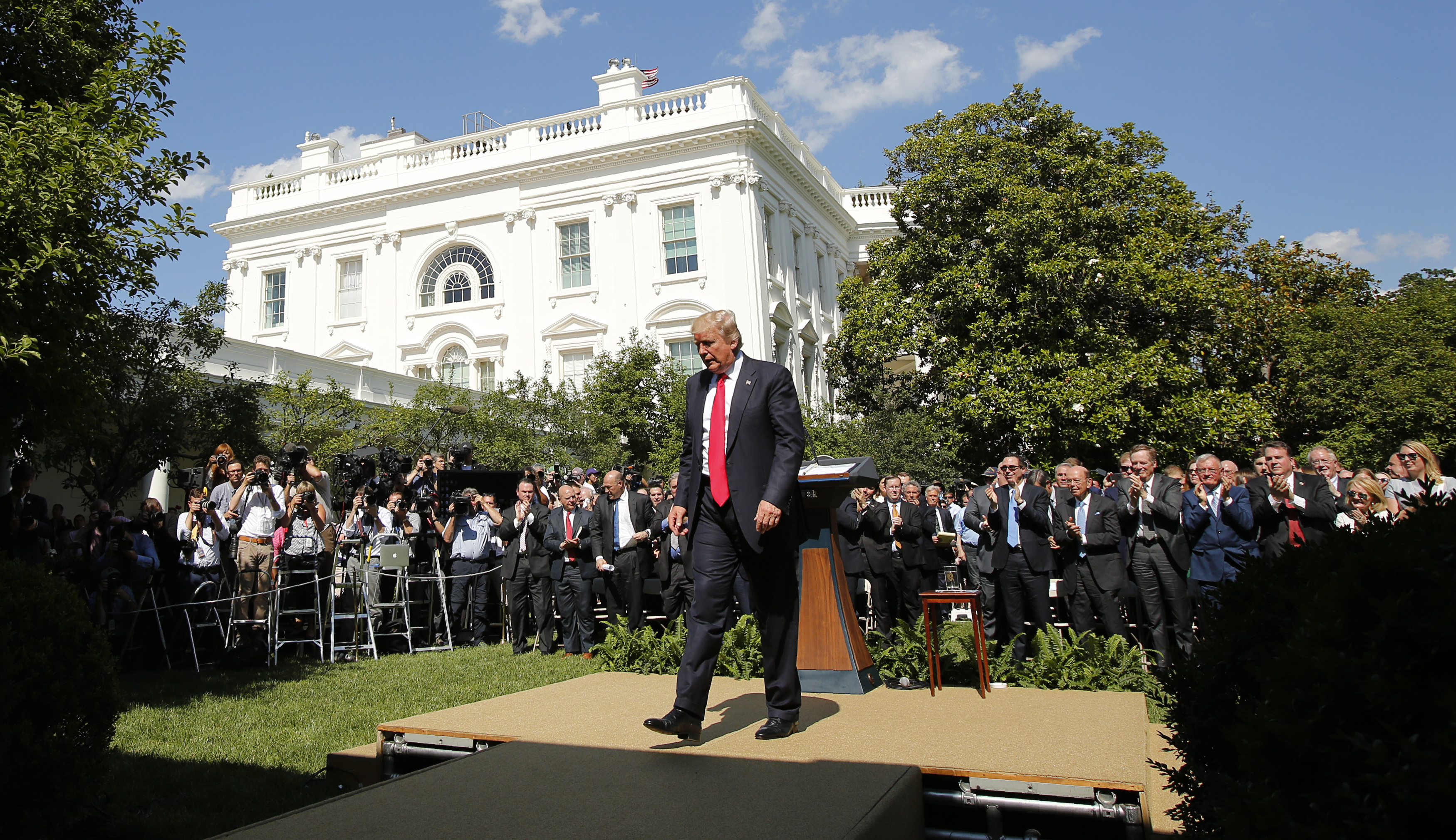 U.S. President Trump departs after announcing his decision to withdraw from Paris Climate Agreement at White House Rose Garden.