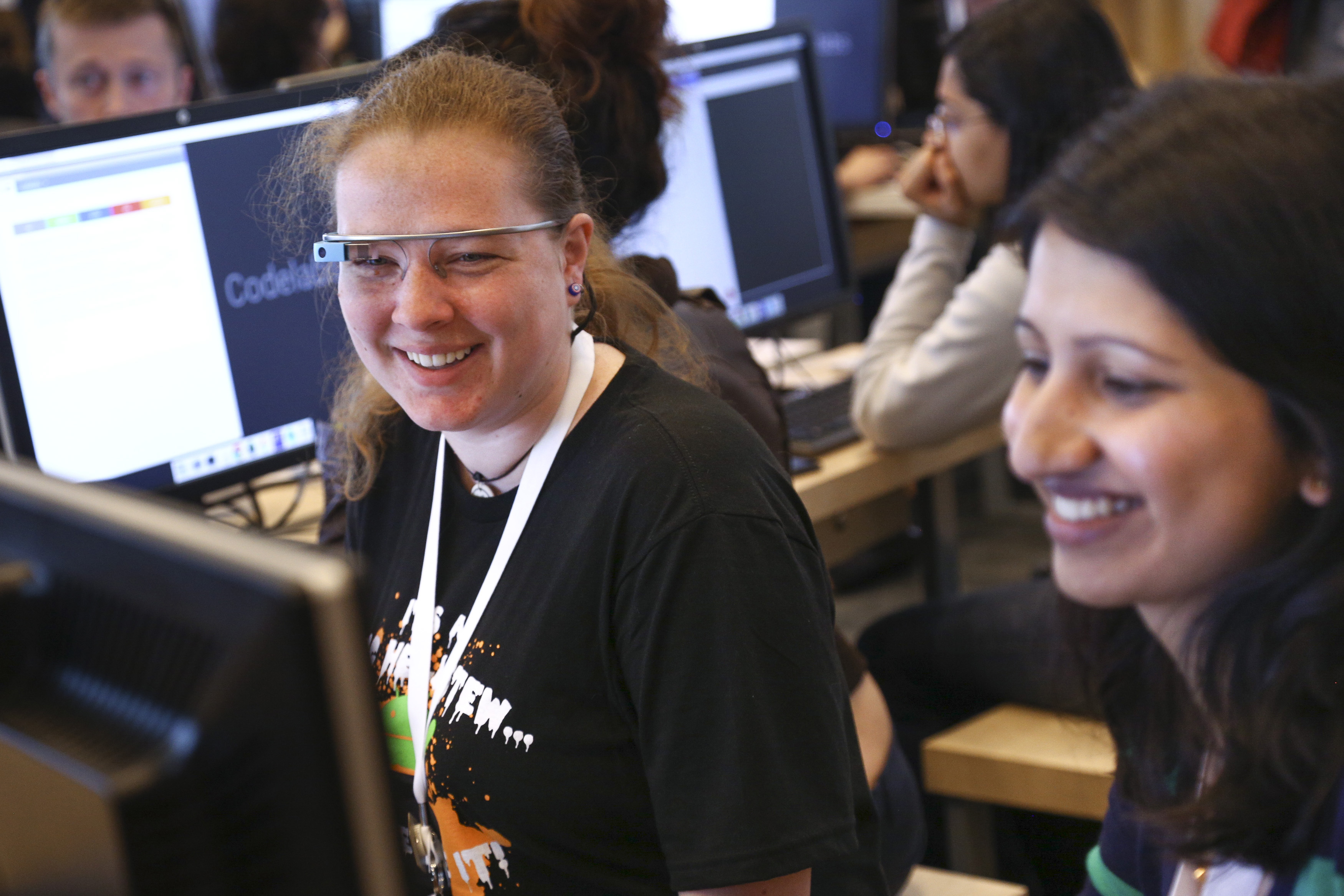 Rachel Wilson (L), of Rockville, Maryland, speaks with Yash Parbhu of Philadelphia, Pennsylvania while learning about the code for some of Google's new APIs at the Google I/O developers conference in San Francisco June 26, 2014. Women attendees constituted 20% of the conference's attendance this year, up from 8% last year. REUTERS/Elijah Nouvelage   (UNITED STATES - Tags: BUSINESS SCIENCE TECHNOLOGY) - GM1EA6R0IP701