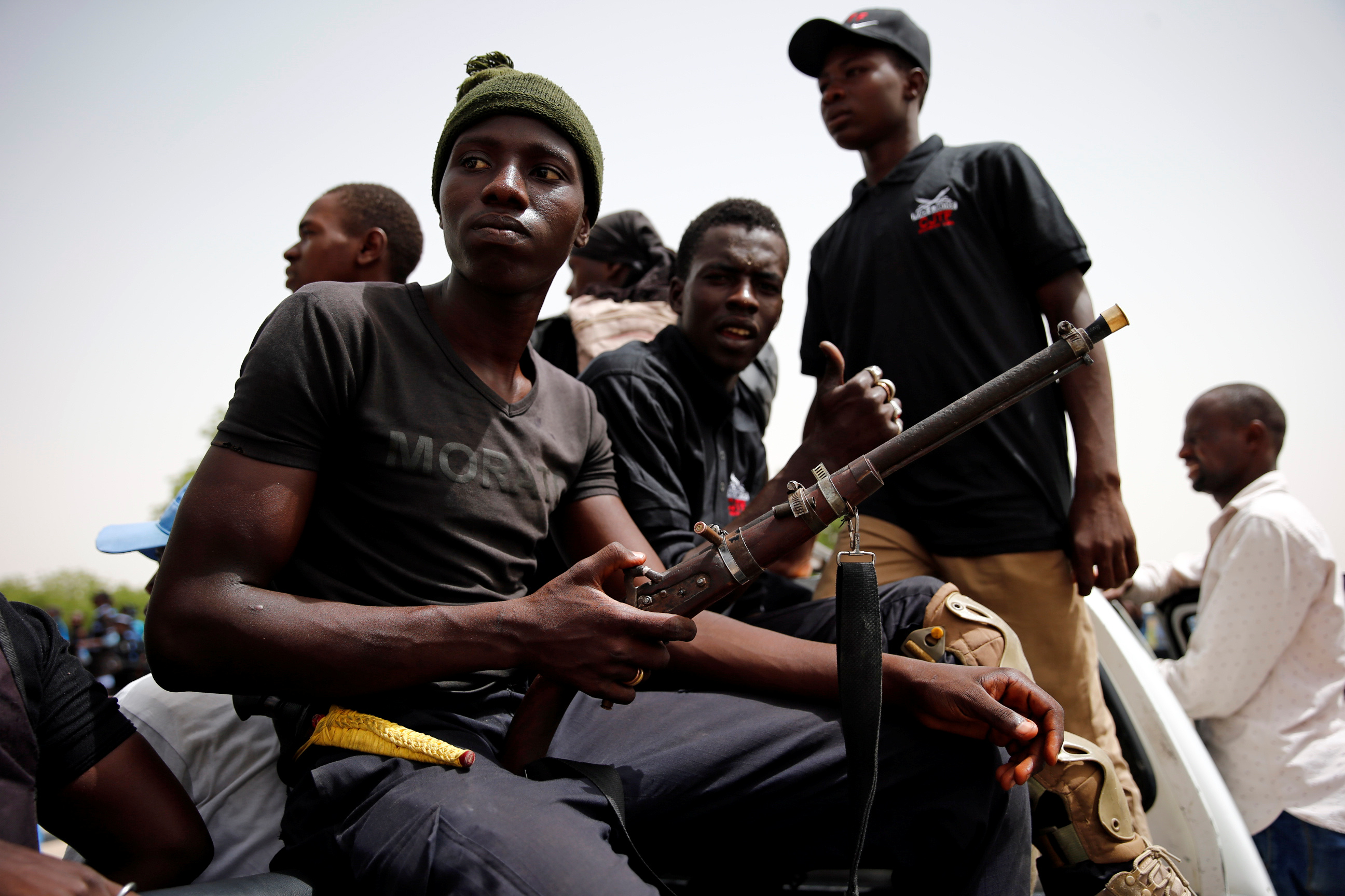 DATE IMPORTED: June 15, 2017 Members of the local militia, otherwise known as CJTF, sit in the back of a truck during a patrol in the city of Maiduguri, northern Nigeria June 9, 2017. Picture taken June 9, 2017. REUTERS/Akintunde Akinleye.