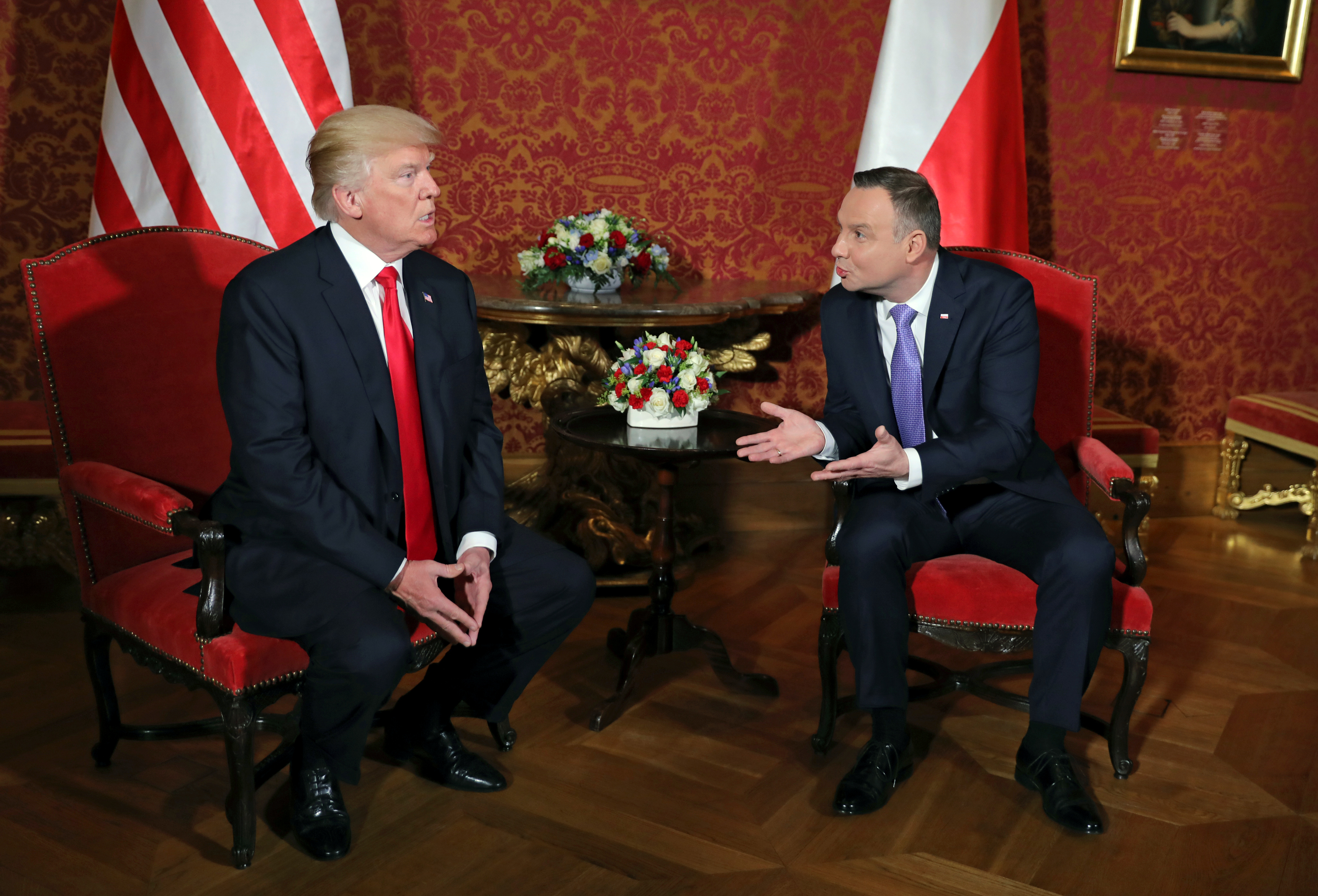 U.S. President Donald Trump talks with Polish President Andrzej Duda during their bilateral meeting, as he visits Poland for the Three Seas Initiative Summit in Warsaw, Poland July 6, 2017. REUTERS/Carlos Barria     TPX IMAGES OF THE DAY - RC135D568260