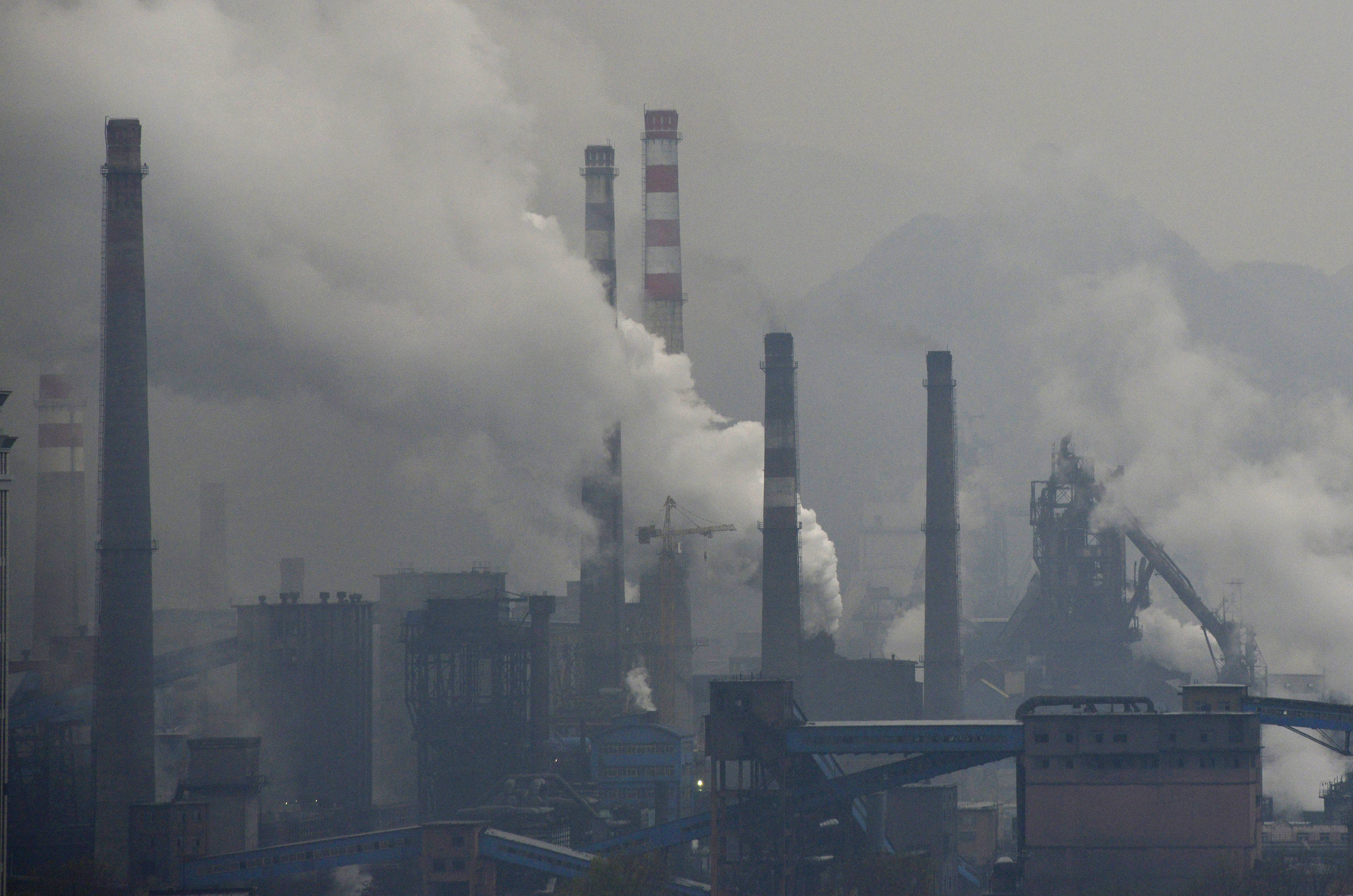 Smoke rises from chimneys and facilities of steel plants on a hazy day in Benxi, Liaoning province November 3, 2013. A chronic shortage of natural gas is hurting China's plan to move away from burning coal to heat homes and offices, raising the prospect of more choking air pollution this winter and beyond. The problem is worst in northern China, where air pollution mainly caused by decades of reliance on coal has lowered life expectancy by an estimated 5.5 years compared to the south, Chinese and international researchers said in July. Picture taken November 3, 2013. REUTERS/Stringer (CHINA - Tags: ENVIRONMENT ENERGY) CHINA OUT. NO COMMERCIAL OR EDITORIAL SALES IN CHINA - GM1E9B40RS301