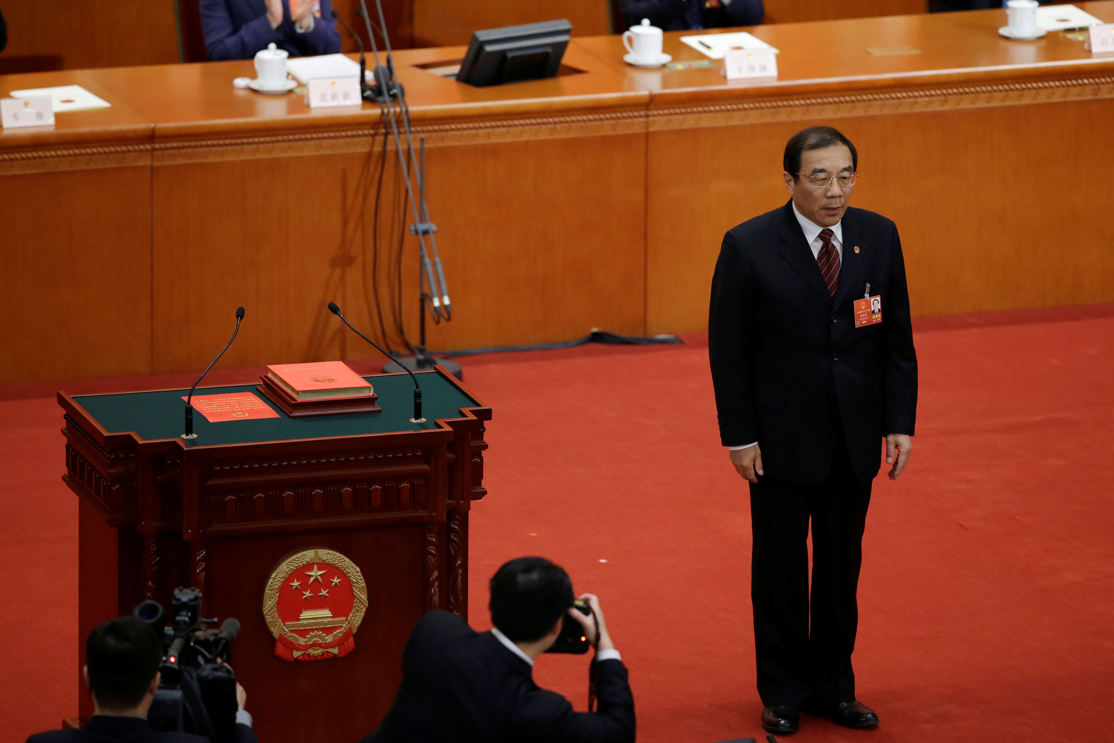 Newly elected head of the National Supervision Commission Yang Xiaodu stands after he takes the oath to the Constitution at the sixth plenary session of the National People's Congress (NPC) at the Great Hall of the People in Beijing, China March 18, 2018.