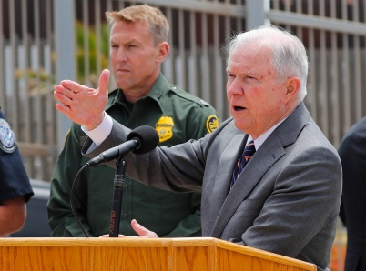 U.S. Attorney General Jeff Sessions speaks during a visit to the U.S. Mexico border wall for a press conference with Immigration and Customs Enforcement Deputy Director Thomas D. Homan, discussing immigration enforcement actions of the Trump Administration near San Diego, California, U.S. May 7, 2018. REUTERS/Mike Blake - HP1EE571L6BQV