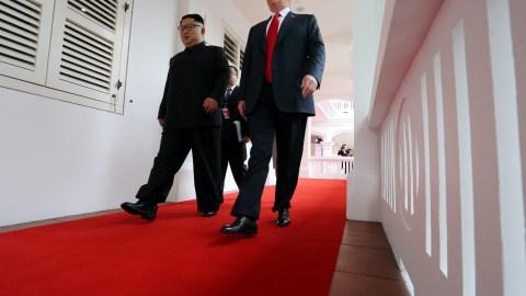 U.S. President Donald Trump walks with North Korean leader Kim Jong Un at the Capella Hotel on Sentosa island in Singapore June 12, 2018. REUTERS/Jonathan Ernst - RC13FC8C39E0