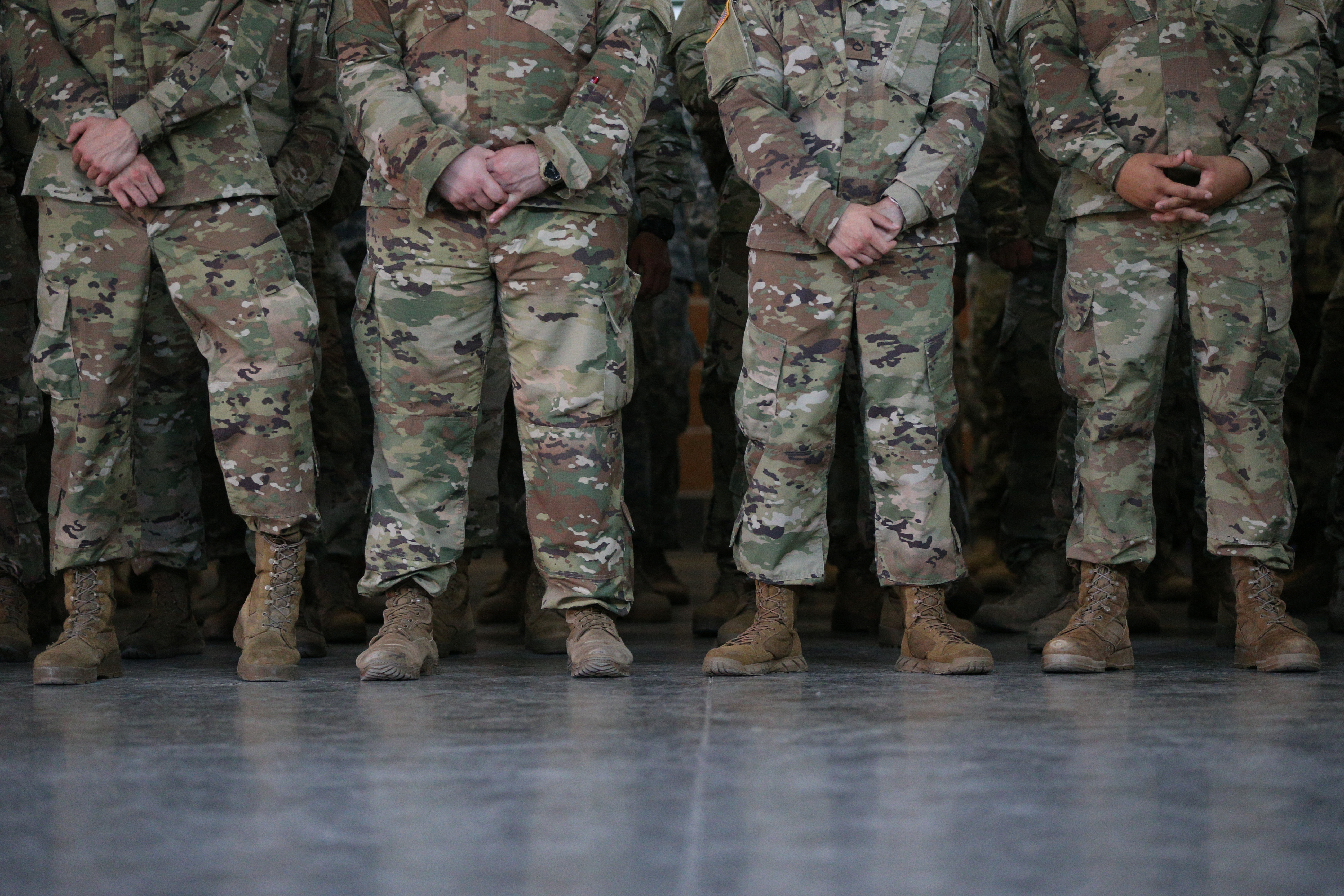 Members of the Texas National Guard wait for Governor Greg Abbott to speak about security on the Mexico-U.S. border at Sergeant Tomas Garces Texas Army National Guard Armory in Weslaco, Texas, U.S., April 12, 2018.  REUTERS/Loren Elliott - RC1FFD3AC1E0