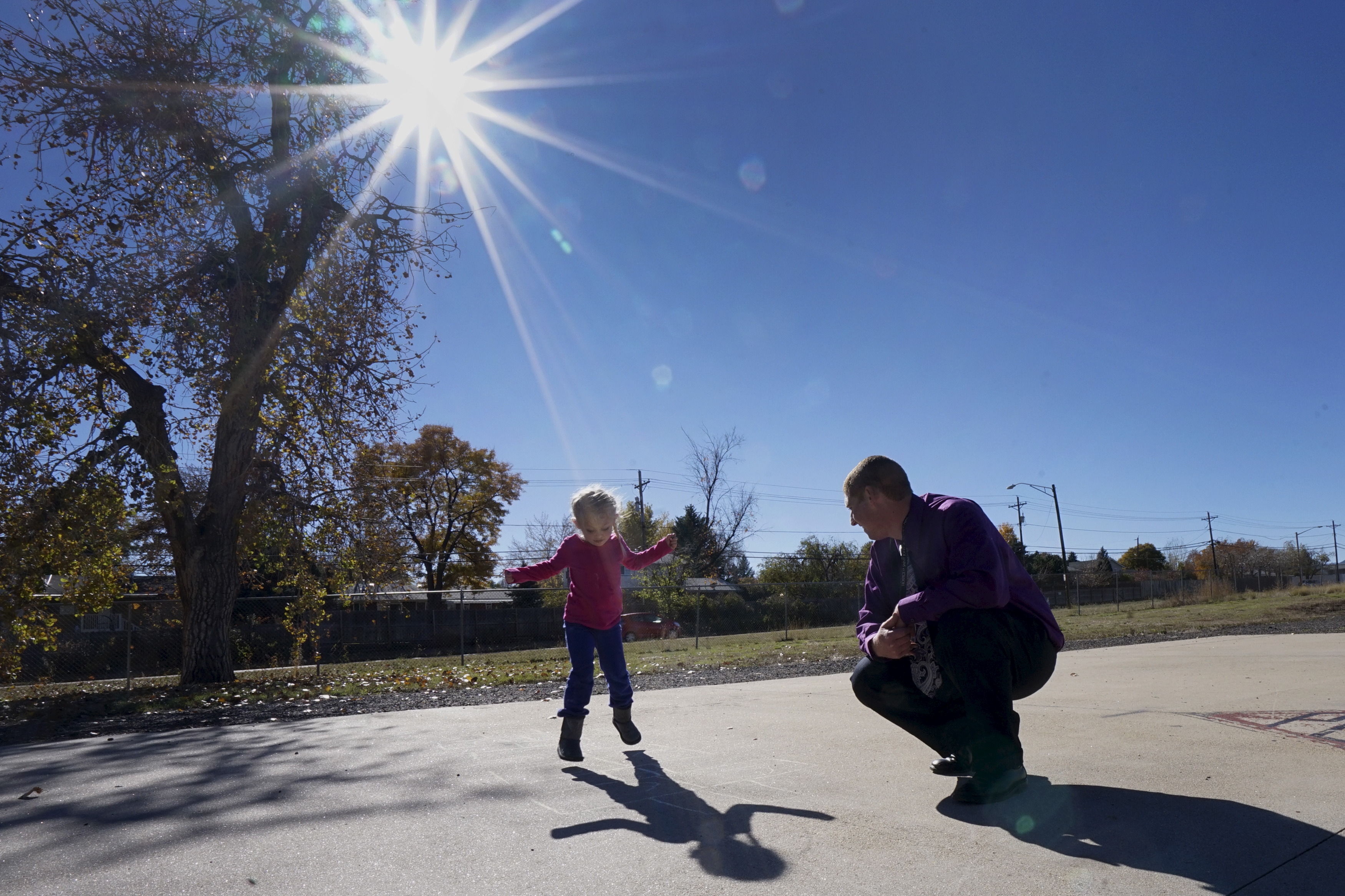 "Peer 1 client Robert A. plays hopscotch with his 5-year-old daughter Isabella during Kid's Day at Peer 1 in Denver November 7, 2015. Peer 1 is a drug and alcohol rehabilitation programme for men, many having spent years in and out of prison, in Denver, Colorado. The men have often tried and failed over and over to turn their life around. With histories of abuse as children and living on the streets, they come to Peer 1 hoping to turn away from addiction and crime, to rebuild their lives and learn how to integrate into society. Treatment includes family group therapy, meditation and trust-building exercises.  REUTERS/Rick WilkingPICTURE 25 OF 26 FOR WIDER IMAGE STORY ""PEER 1: PRISON, DEATH OR RECOVERY"". SEARCH ""PEER WILKING"" FOR ALL IMAGES - GF20000082782"
