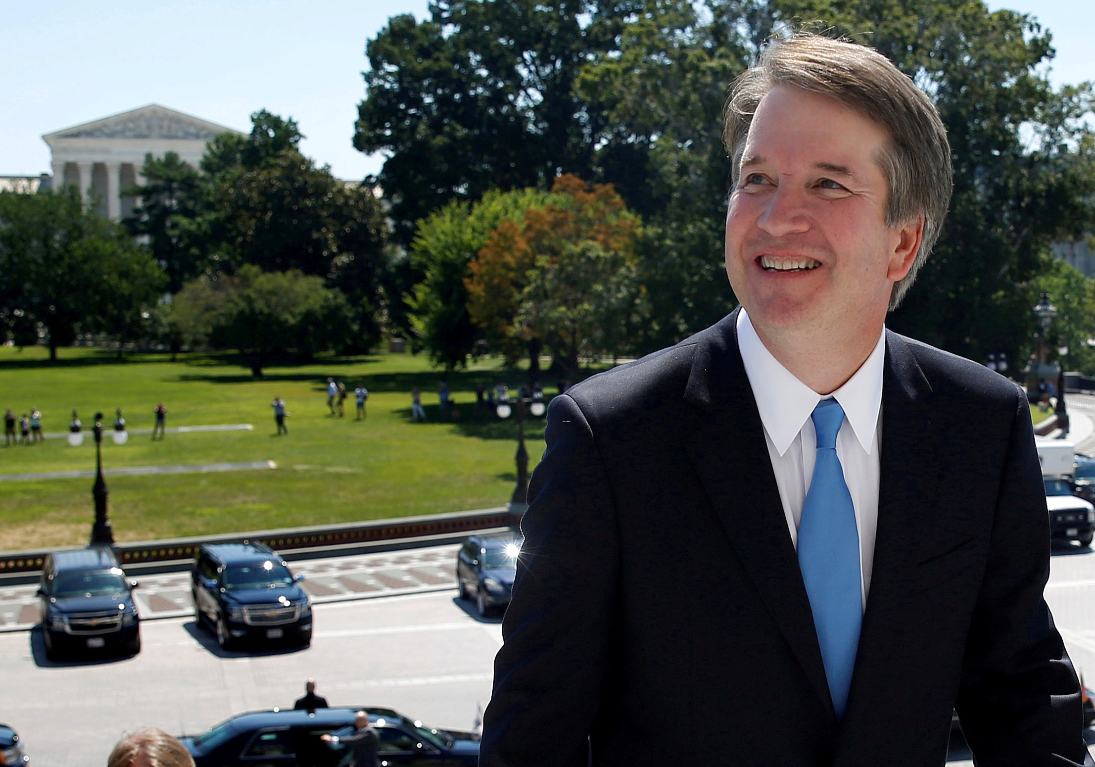 FILE PHOTO:    With the U.S. Supreme Court building in the background, Supreme Court nominee judge Brett Kavanaugh arrives prior to meeting with Senate Majority Leader Mitch McConnell on Capitol Hill in Washington, U.S., July 10, 2018. REUTERS/Joshua Roberts/File Photo - RC193B83C020